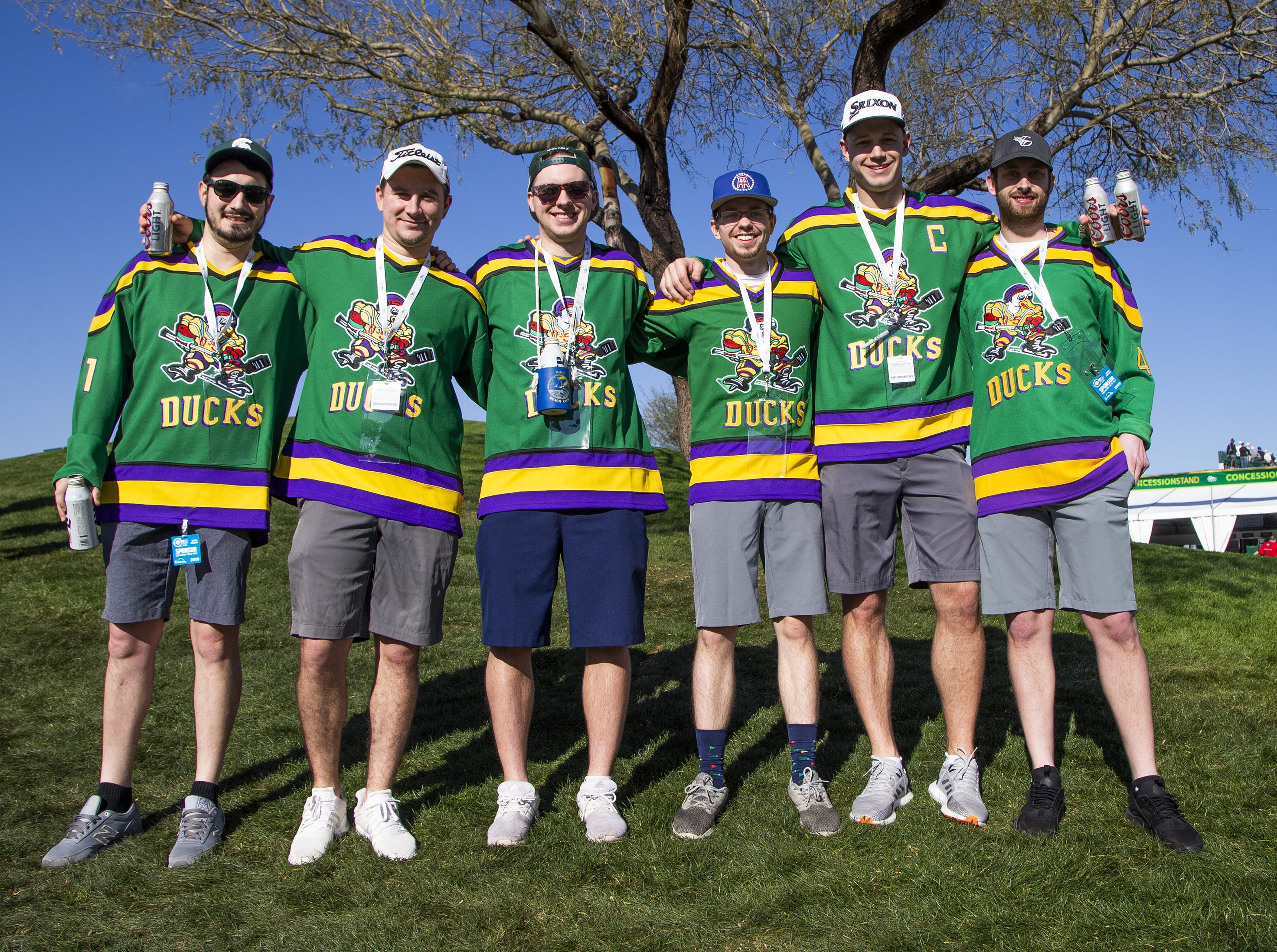 Friends from Grand Rapids, Michigan, dressed up in jerseys for The Mighty Ducks movie for the second round of the Waste Management Phoenix Open at the TPC Scottsdale, Friday, February 1, 2019.  From left to right are; Sam Cusmano, 28, Andy Brown, 28, Tyler Allard, 27, Michael Matusiak, 24, Derek Lennen, 27, and Cole Dehen, 28.