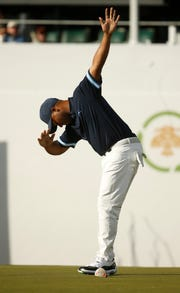 Harold Varner III dabs after making birdie on the 16th hole during the  first round of the WM Phoenix Open at TPC Scottsdale.