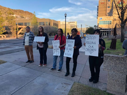 Several people gather outside Tempe City Hall on Jan. 31, 2019, in protest of the fatal police shooting of 14-year-old Antonio Arce.