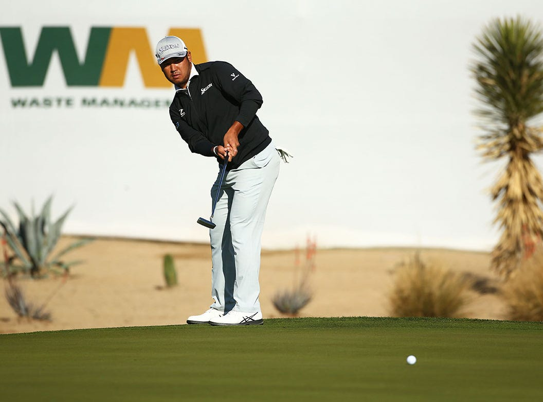 Hideki Matsuyama plays his second shot on the 17th hole during second round action on Feb. 1 during the Waste Management Phoenix Open at the TPC Scottsdale Stadium Course.