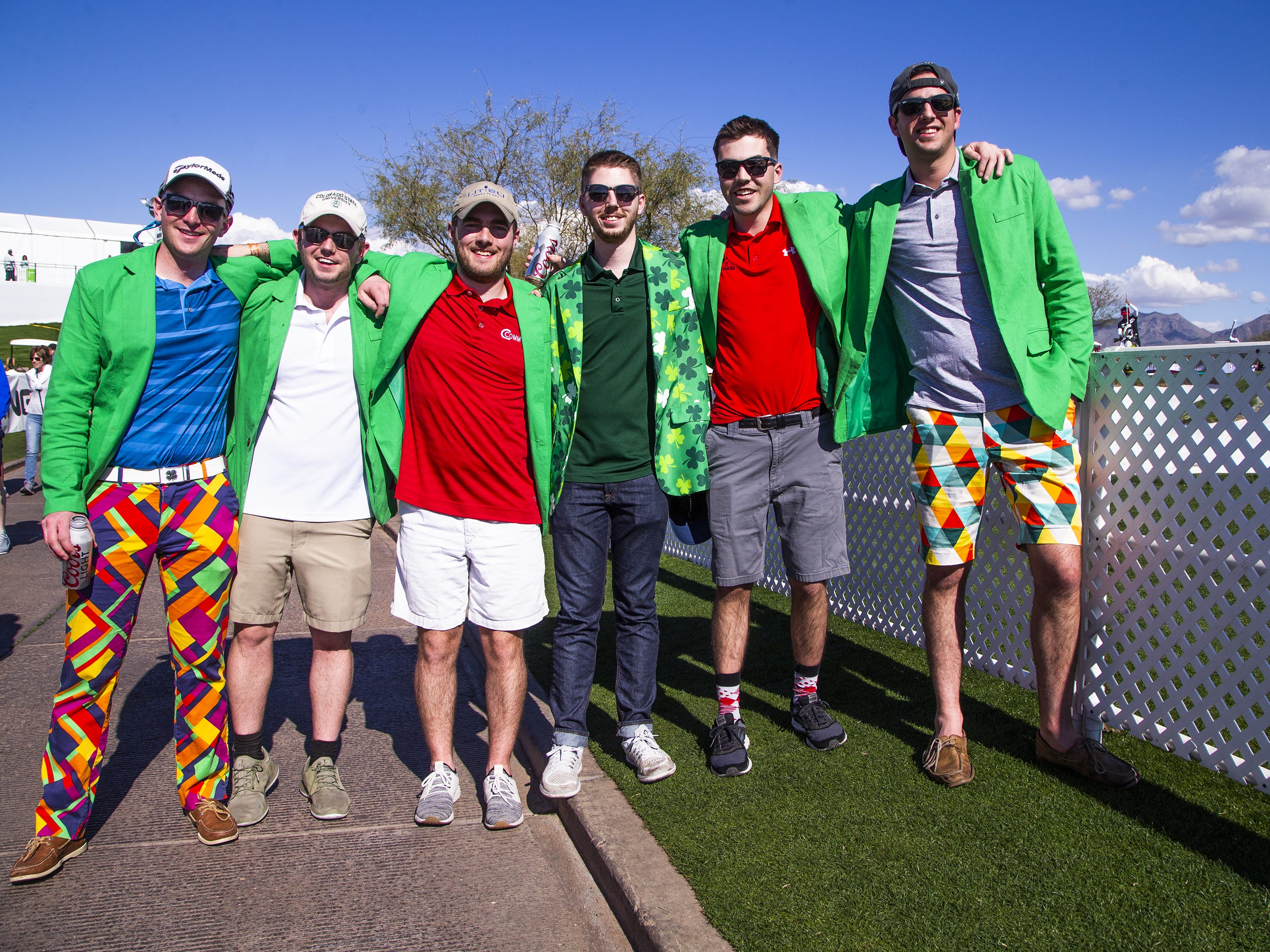 Friends all wear green jackets during the second round of the Waste Management Phoenix Open at the TPC Scottsdale, Friday, February 1, 2019.  From left to right are; Ian Rice, 24, Denver, Colorado, Scott Drees, 23, Covington, Kentucky, Jacob Willard, 23, Austin, Texas, Austin Singletary, 24, Denver, Jack Langford, 23, Centennial, Colorado,  and Patrrick Edler, 24, Denver.