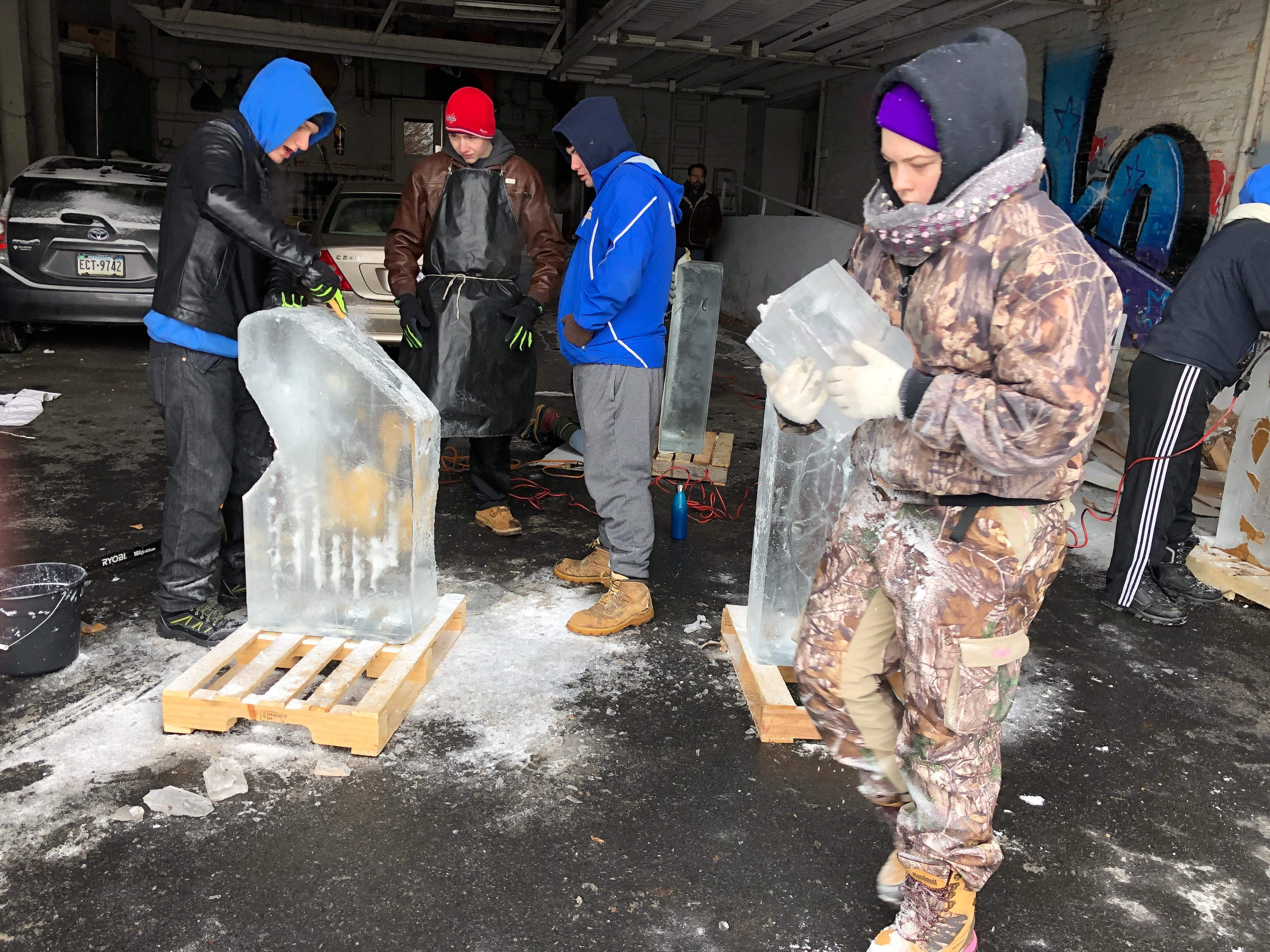 Progress. As LCCTC apprentices put a serious dent in their projects, they need to haul pieces of the ice away.