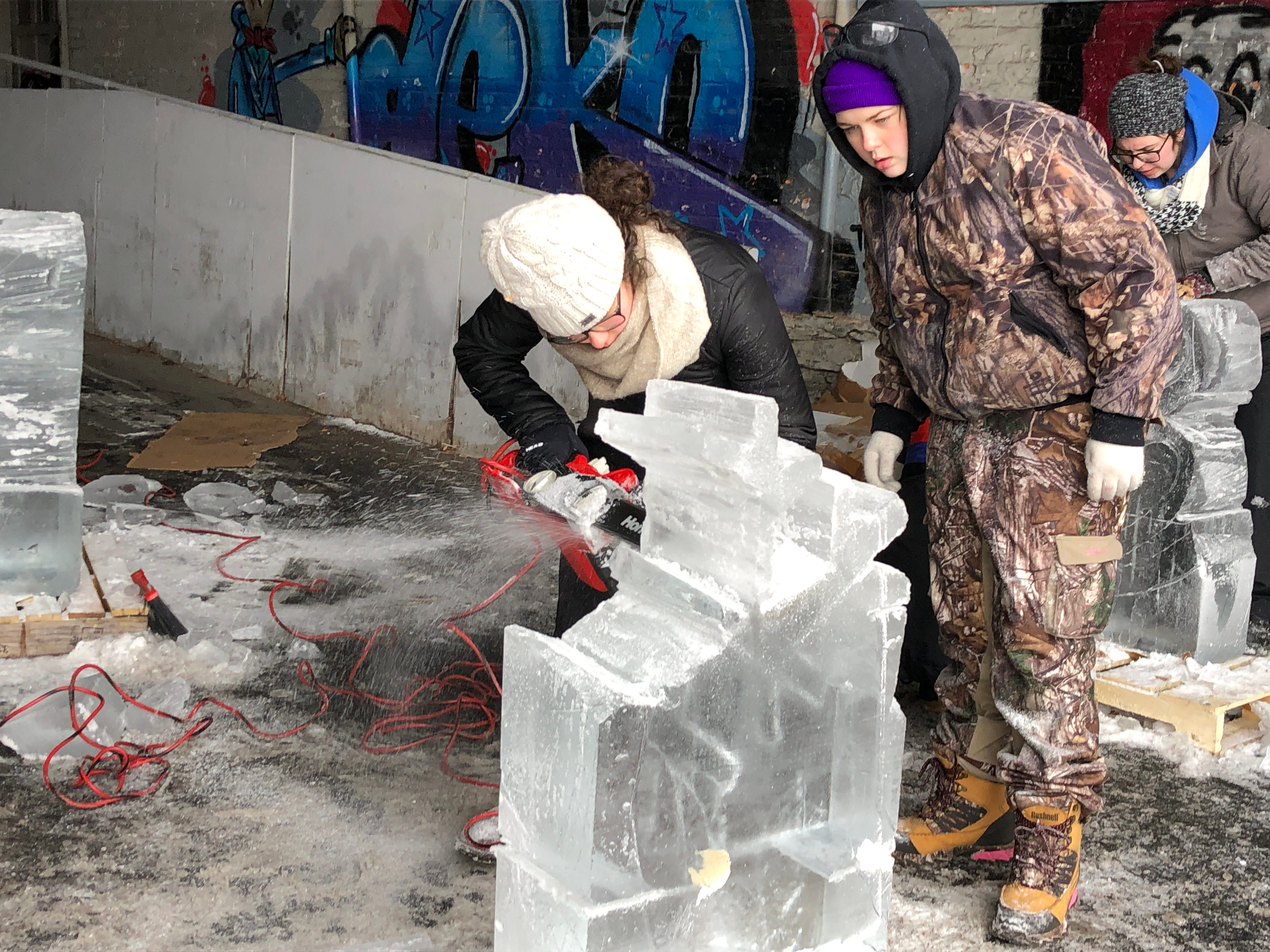 Corina Henry (left) and Hanna Koehler are back to work on their snowflake after the unfortunate mishap.