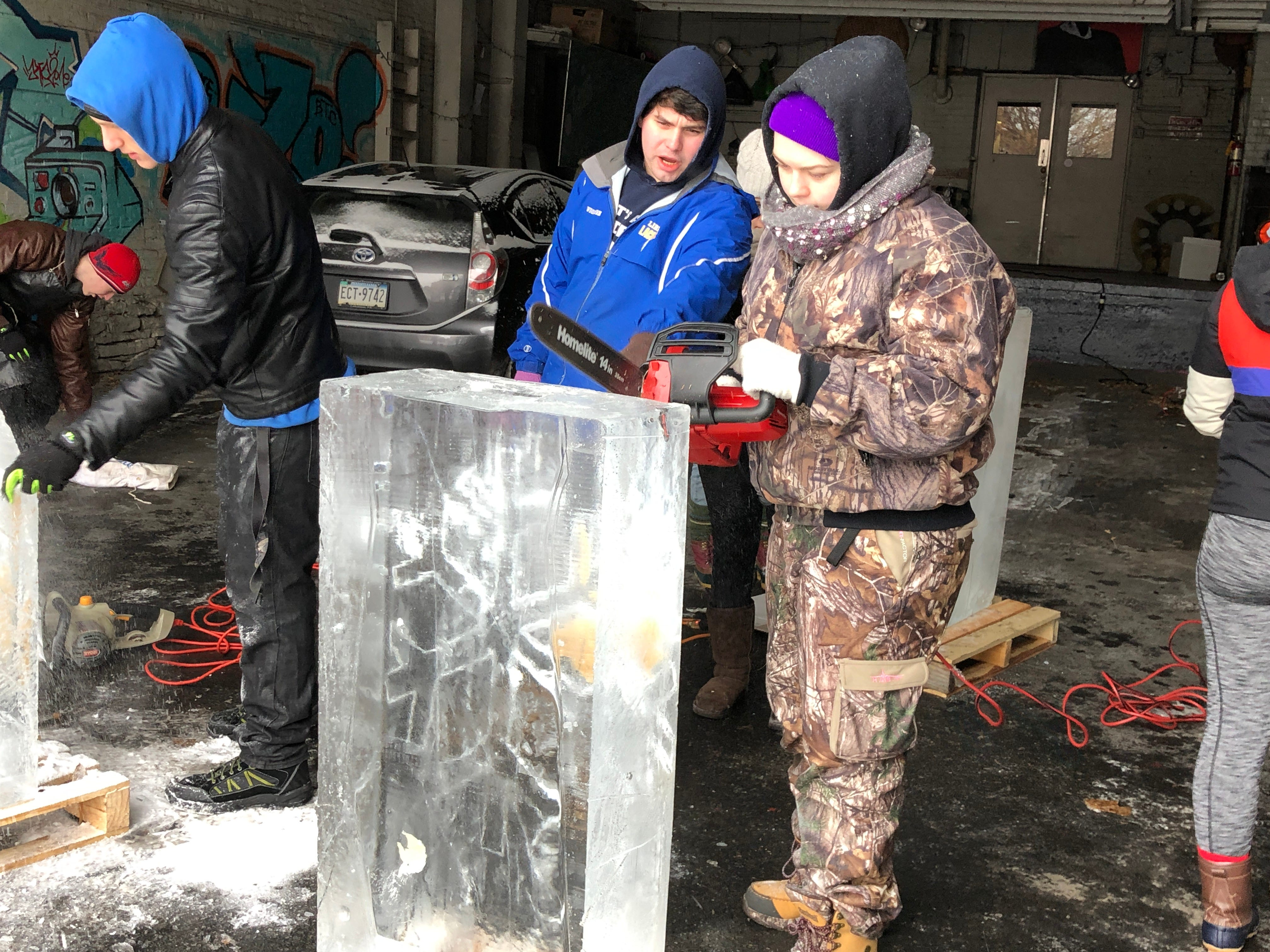 Hanna Koehler gets ready to cut into a block of ice for the first time. The other LCCTC apprentices have tried their hand at ice carving before.