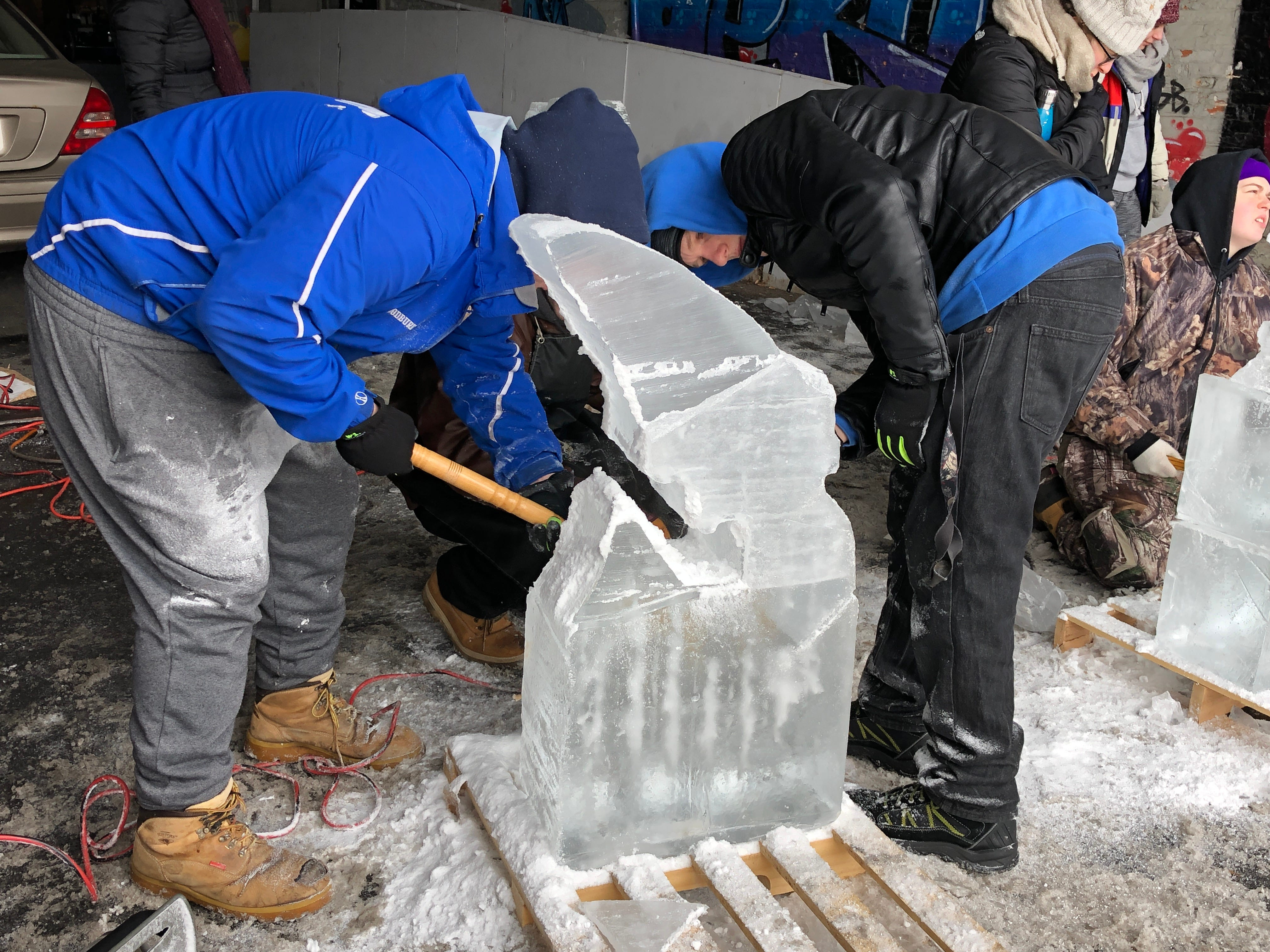 Connor Woodburn (left) and Brandon Mullins continue chipping away at their ice.