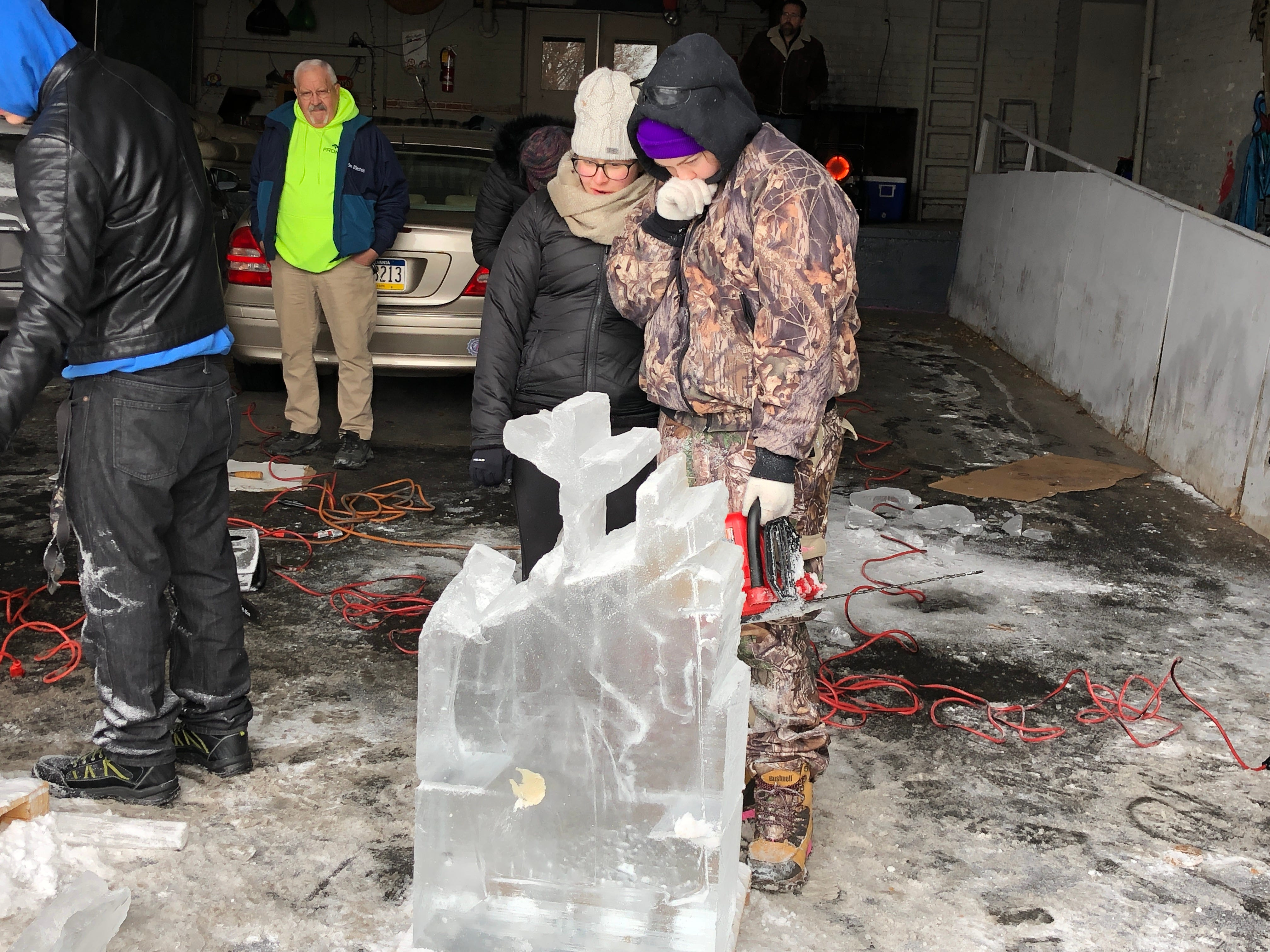 Uh oh. Corina Henry (left) and Hanna Koehler got a bad block of ice, and a crack caused a chunk to break. They were troopers, though, finishing the sculpture anyway.