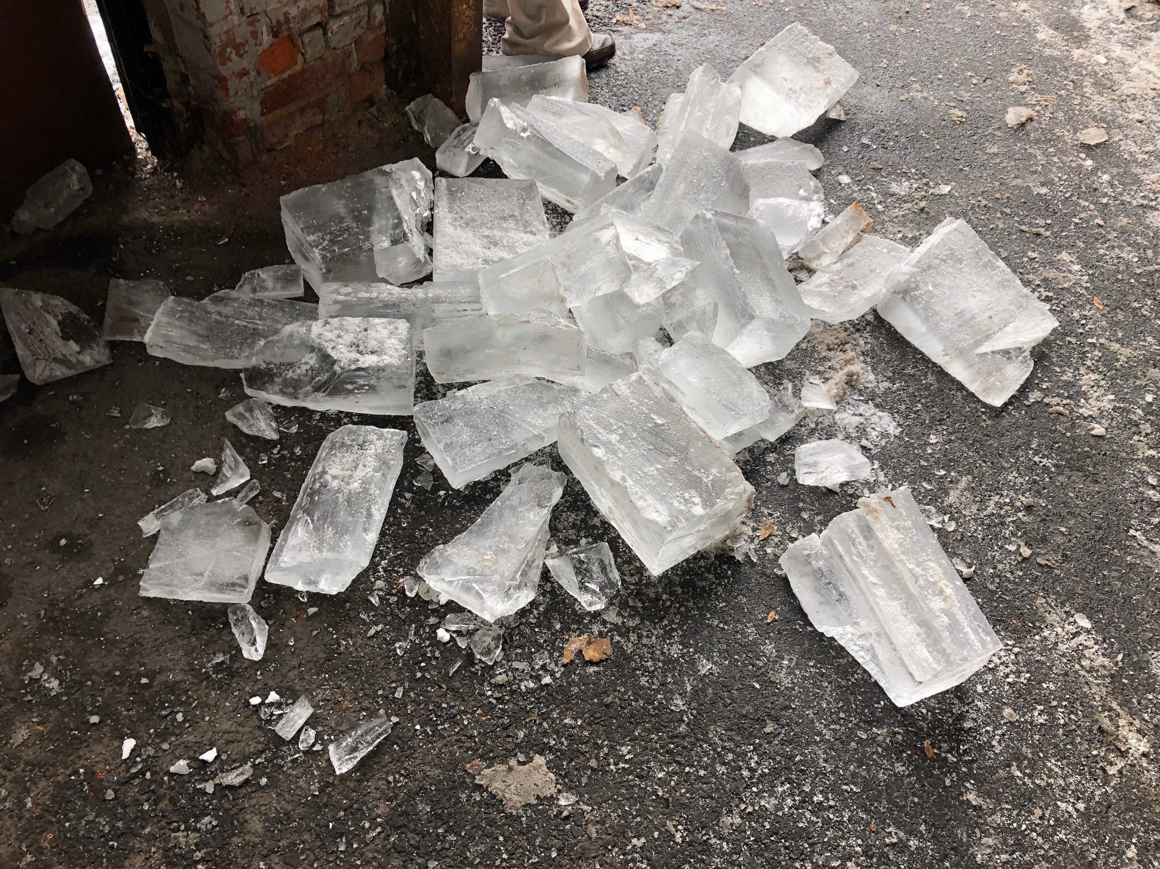 A pile of discarded ice, one of several on the found in the garage at Scott Church Studios when the carving is complete.