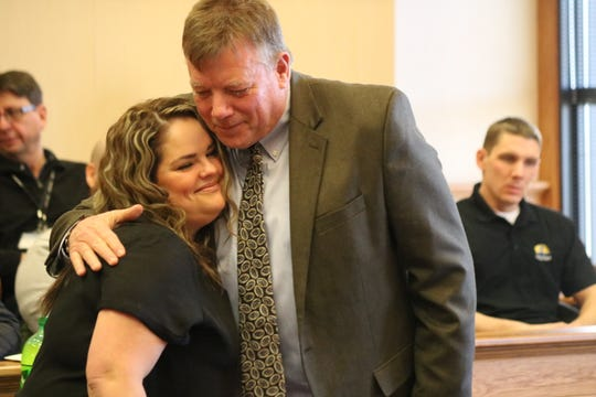 Judge Bruce Winters hugs and congratulates Kylie Zunk, who graduated from the Ottawa County Drug Court program.
