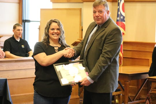 Judge Bruce Winters, right, presents a certificate of graduation to Kylie Zunk, who completed the Ottawa County Drug Addiction Treatment Alliance Program, or Drug Court.