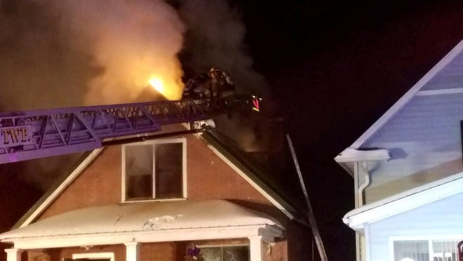Firefighters battle a house fire on Stanton Street in Port Huron Thursday evening.