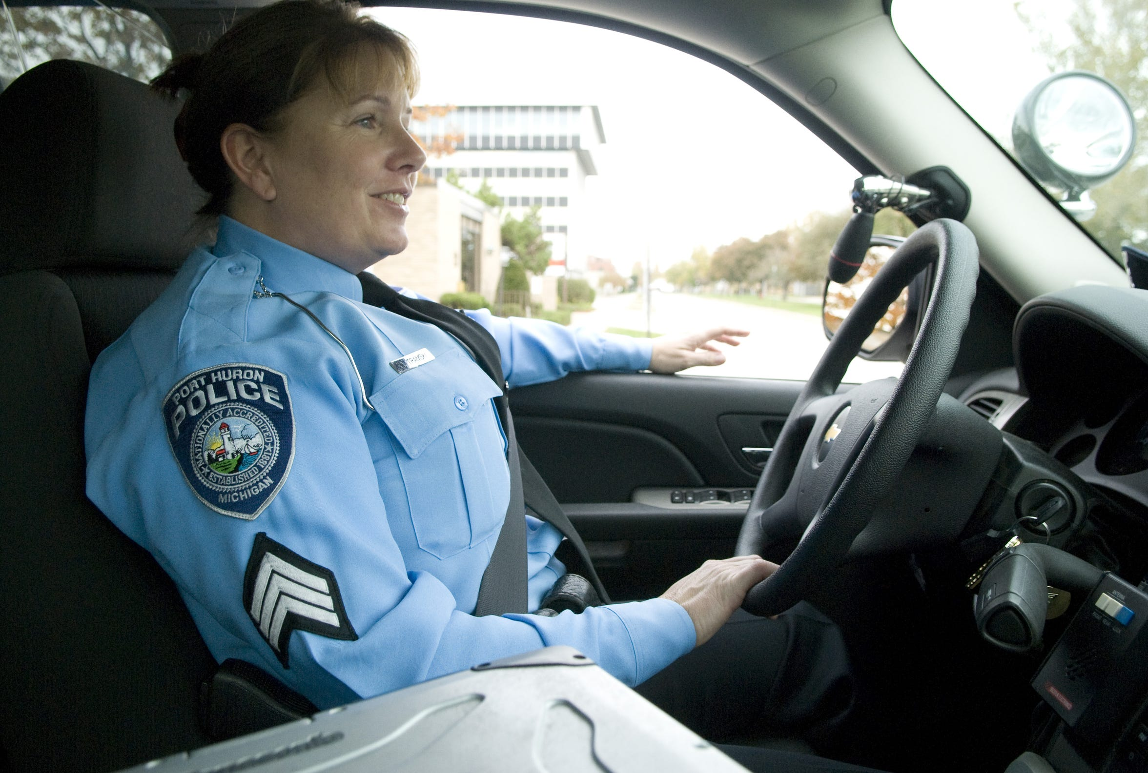 Sgt. Diana Tramski rides in her patrol vehicle through downtown Port Huron in October 2010. She was the first female officer employed by the Port Huron Police Department and a mentor cited among the force's long-time female officers.