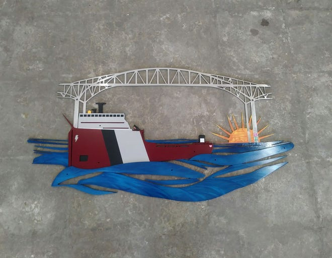 Tough Weld Fabrication made this sign for Robin Ferguson of Marysville. The bridge represents Ferguson's father, who worked on the bridge, the pink rose on the bridge stands for her mother, the pink heart on the freighter stands for Ferguson's daughter, and the robin perched on the freighter stands for Ferguson herself.