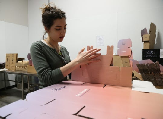 Cara Zebrowski prepares packaging for cans of Recess during a production run at Drink More Good's production facility in East Fishkill on January 31, 2019.