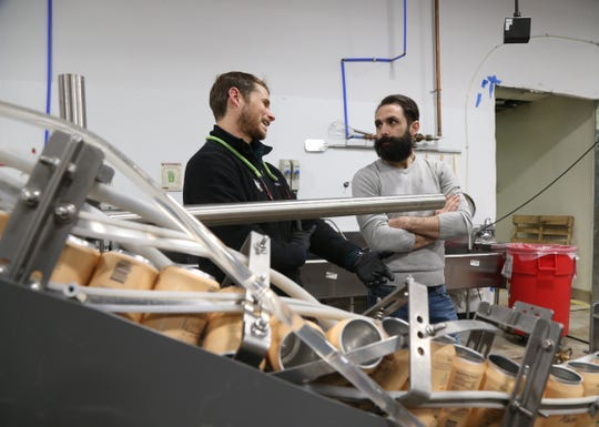From left, Todd Hundley of Iron Heart Canning talk with Drink More Good CEO Jason Schuler during a production run of Recess at Drink More Good's production facility in East Fishkill on January 31, 2019. Recess, which is produced under contract by Drink More Good is a CBD-infused beverage.