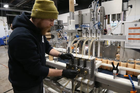 Adam Roesnthall of Iron Heart Canning adjusts the mobile canner during a production run of Recess at Drink More Good's production facility in Hopewell Junction on January 31, 2019. Recess, which is produced under contract by Drink More Good is a CBD-infused beverage.