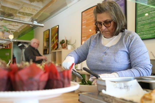 Lynn Miller, owner of Veggie Go-Go prepares a salad at the cafe in Wappingers Falls on January 31, 2019.