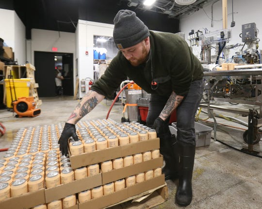 Dillon Harrison moves a flat of freshly canned Recess during a production run at Drink More Good's production facility in East Fishkill on January 31, 2019.