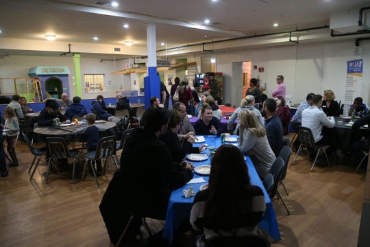 Furloughed and unpaid government workers gather at the Mid-Hudson Children's Museum for a free meal on January 24, 2019. Local restaurants donated food to help the workers during the shut down.