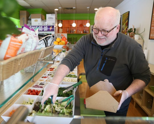 Greg Miller, owner of Veggie Go-Go prepares a salad at the cafe in Wappingers Falls on January 31, 2019.