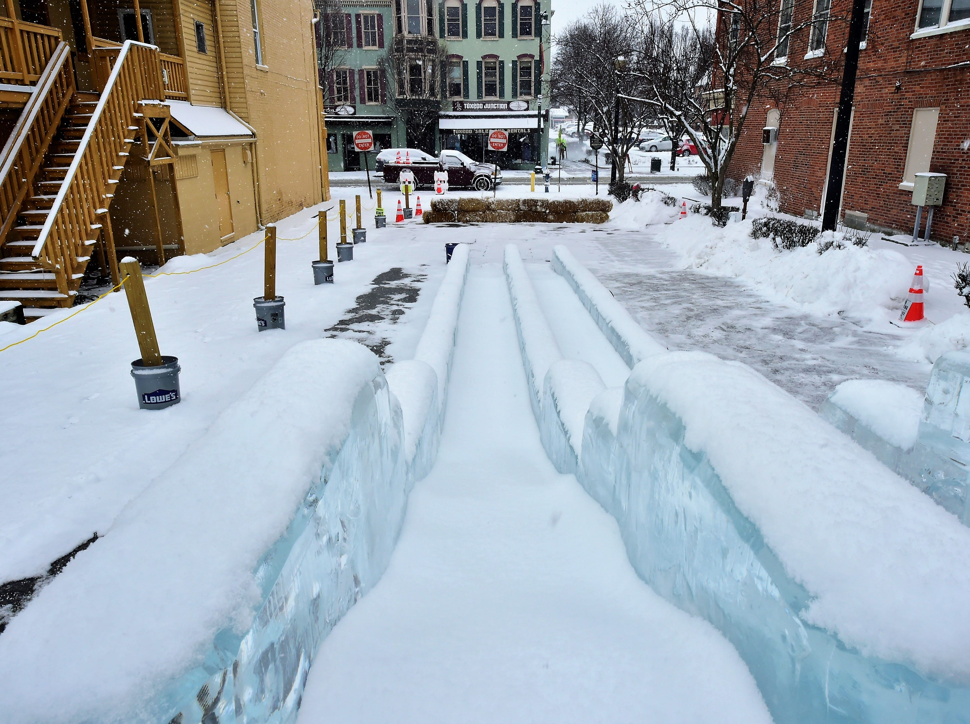The view from the top of the 40-foot-long, double-wide ice slide, in the lot next to Gartenberg Jewelry on South Main St. DiMartino Ice Company carved around 80 ice sculptures for IceFest 2019 in Chambersburg. Here is a small fraction of them. All of the sculptures pictured in this gallery are located on South Main Street between the square and Washington Street.