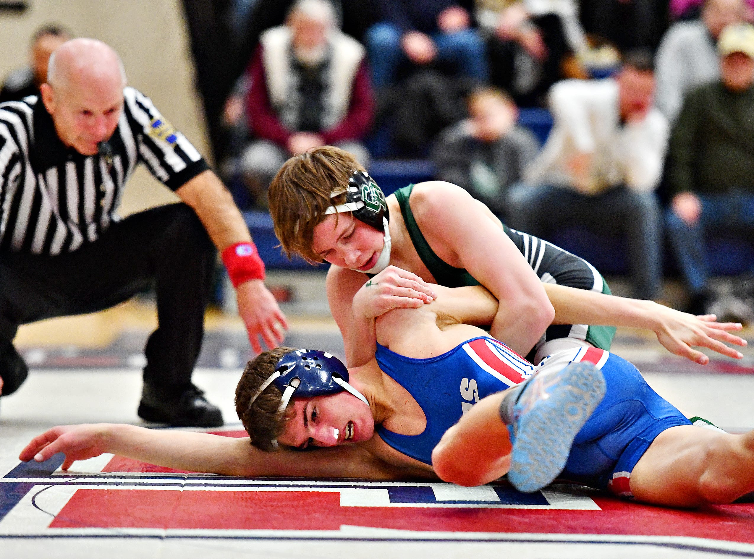 Dallastown's Carter MacDonald, front, wrestles Central Dauphin's Liam Kennedy in the 120 pound weight class during District 3, Class 3A wrestling semifinal action at Spring Grove Area High School in Jackson Township, Thursday, Jan. 31, 2019. Dawn J. Sagert photo
