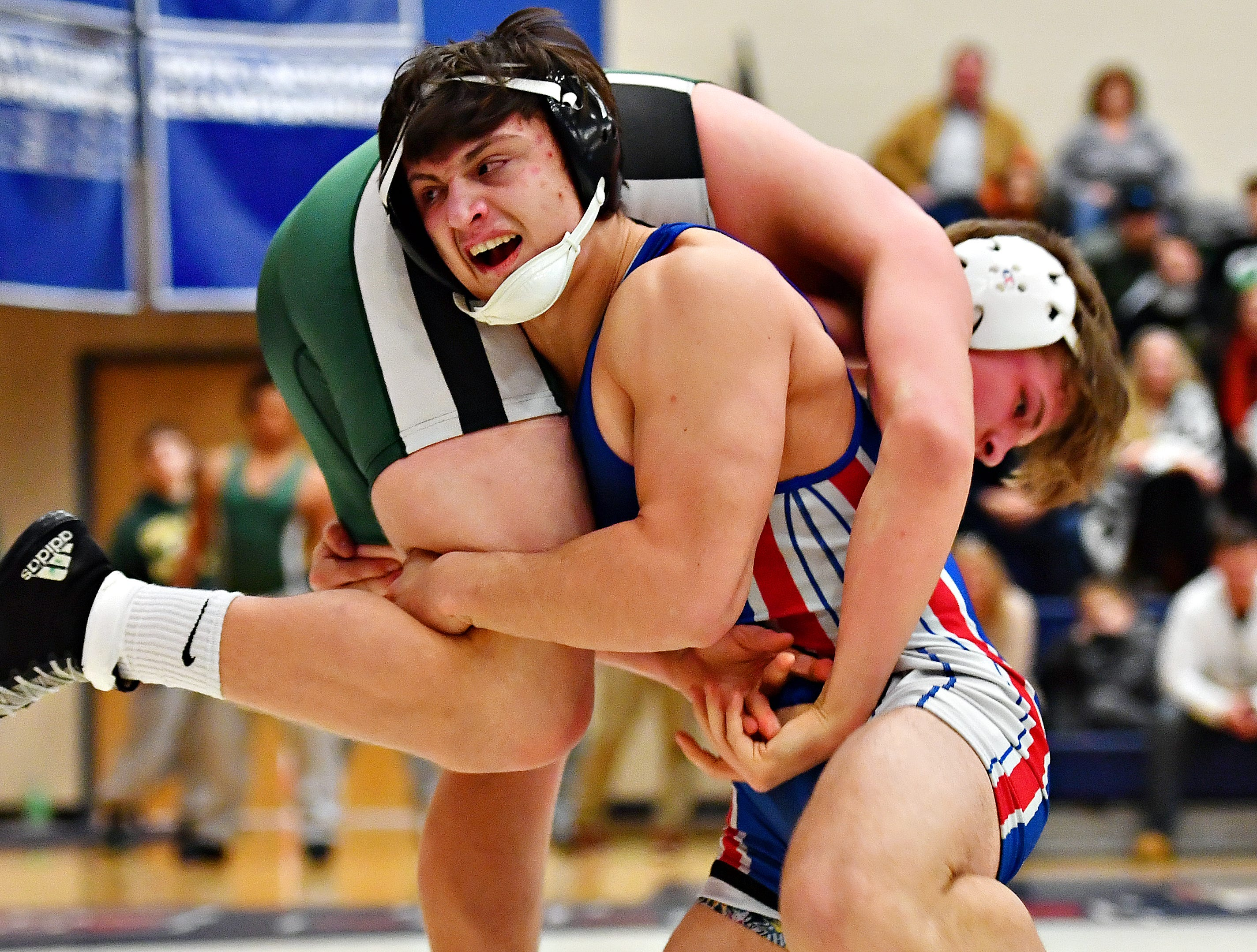 Dallastown's Franklin Klinger, front, wrestles Central Dauphin's Nathaniel Mosey in the 182 pound weight class during District 3, Class 3A wrestling semifinal action at Spring Grove Area High School in Jackson Township, Thursday, Jan. 31, 2019. Dawn J. Sagert photo
