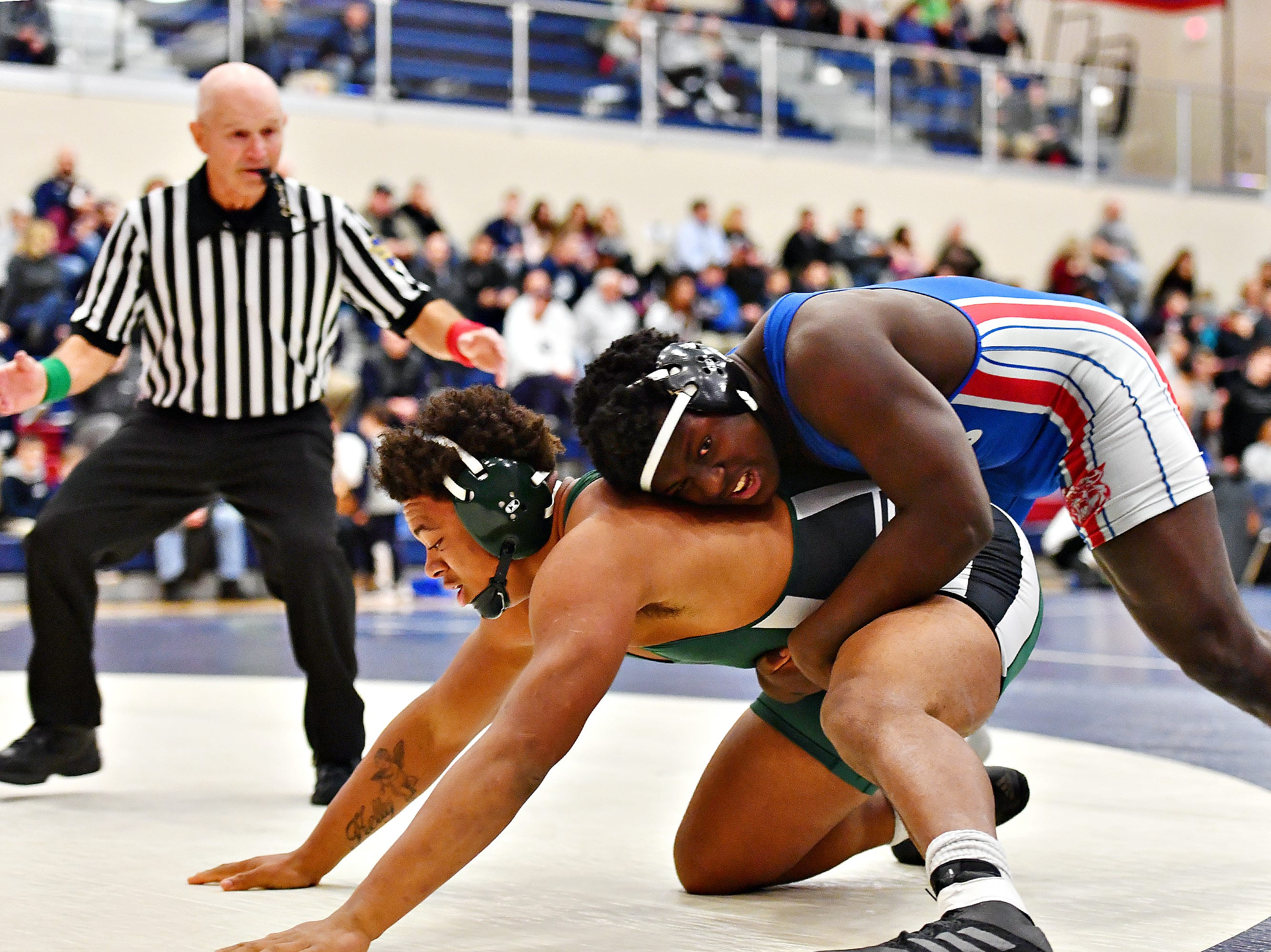 Dallastown's Jamal Brandon, right, wrestles Central Dauphin's Marques Holton in the 220 pound weight class during District 3, Class 3A wrestling semifinal action at Spring Grove Area High School in Jackson Township, Thursday, Jan. 31, 2019. Dawn J. Sagert photo