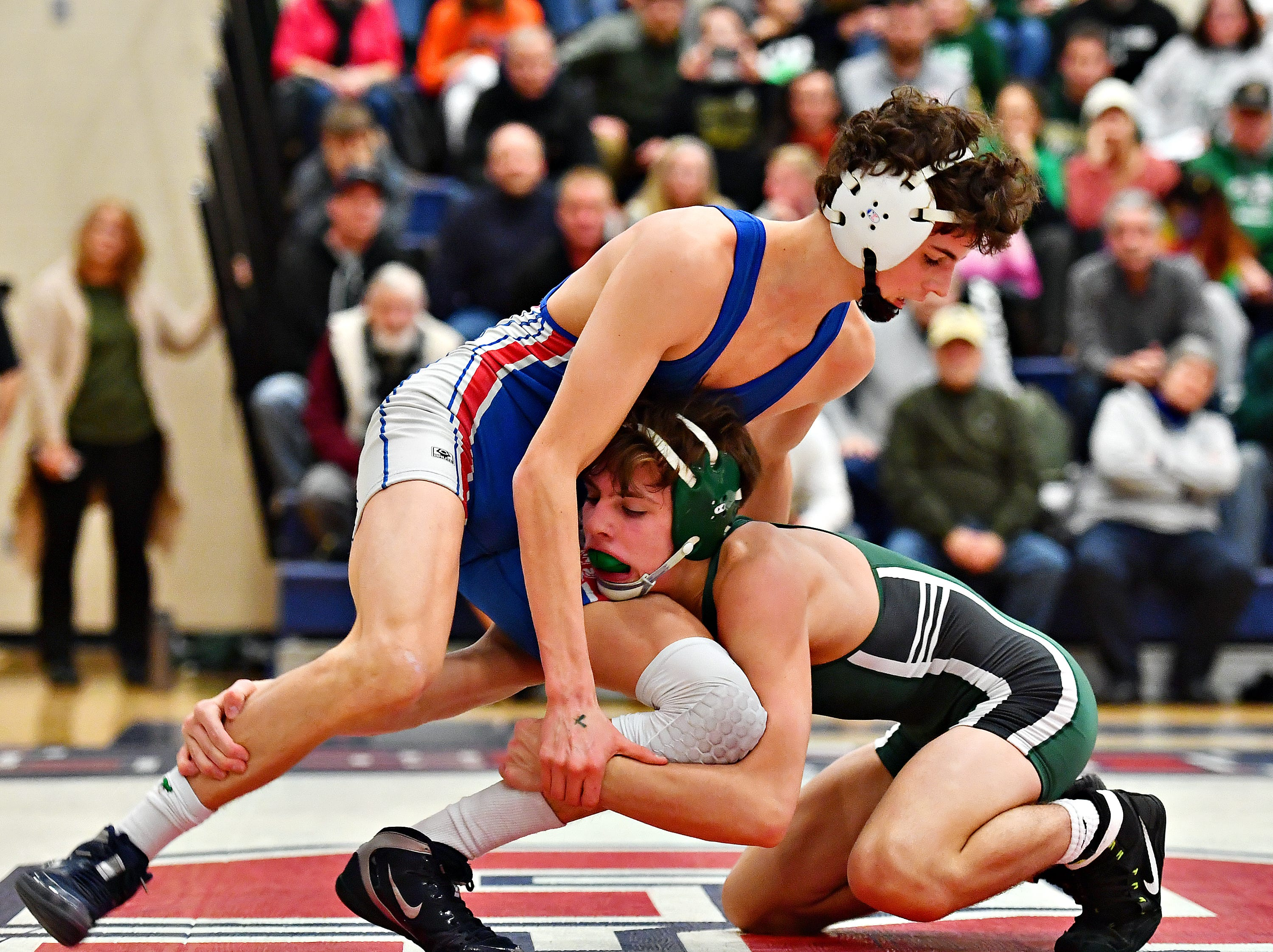 Dallastown's Cael Turnbull, left, wrestles Central Dauphin's Bryce Buckman in the 132 pound weight class during District 3, Class 3A wrestling semifinal action at Spring Grove Area High School in Jackson Township, Thursday, Jan. 31, 2019. Dawn J. Sagert photo