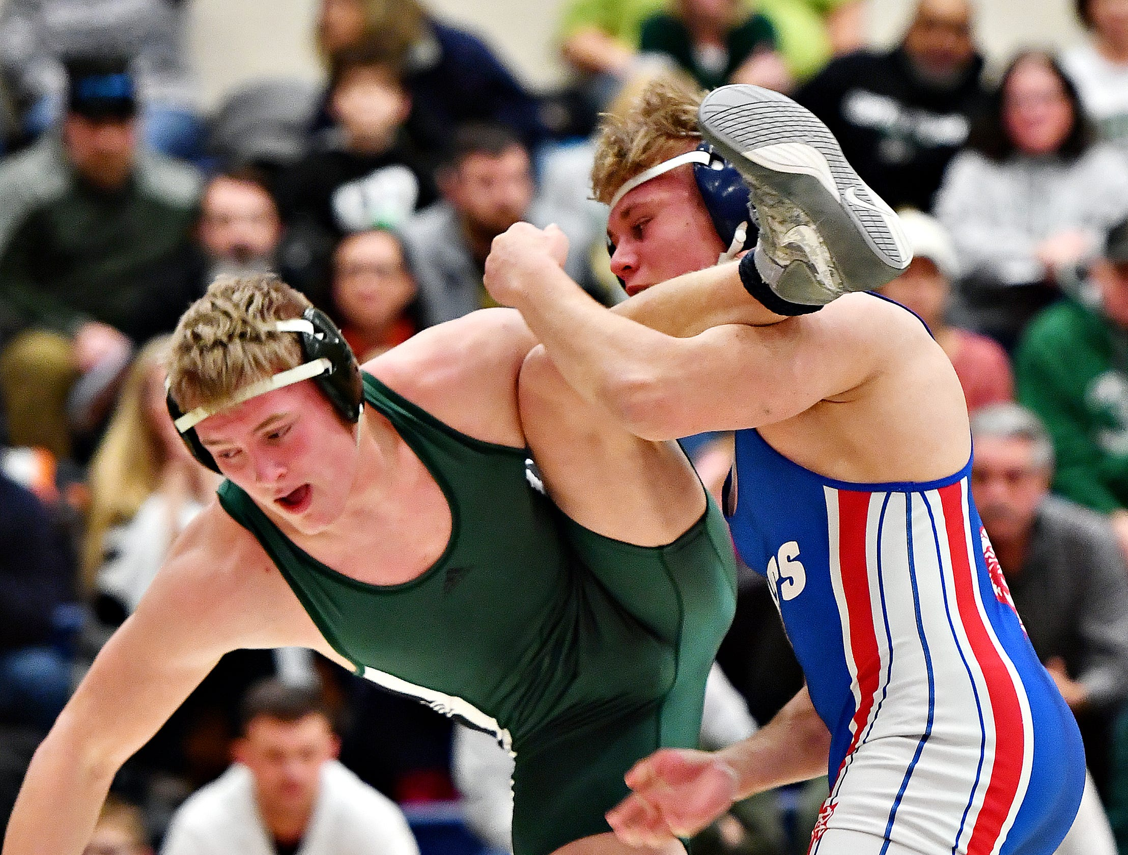 Dallastown's Jarrett Feeney, right, wrestles Central Dauphin's Jackson Talbott in the 195 pound weight class during District 3, Class 3A wrestling semifinal action at Spring Grove Area High School in Jackson Township, Thursday, Jan. 31, 2019. Dawn J. Sagert photo