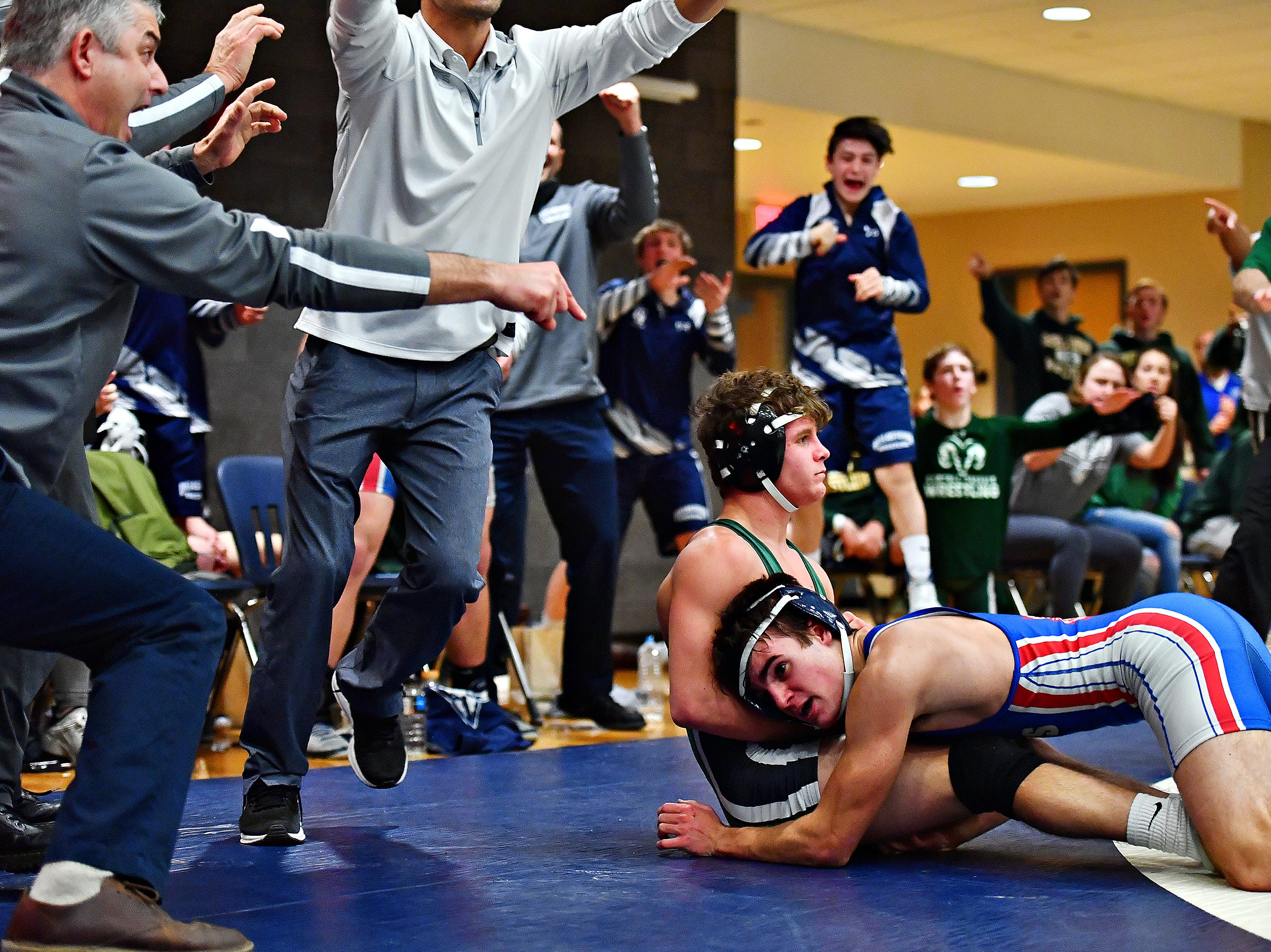 Dallastown's Donovan Trauger, right, wrestles Central Dauphin's Tyler Faust in the 126 pound weight class during District 3, Class 3A wrestling semifinal action at Spring Grove Area High School in Jackson Township, Thursday, Jan. 31, 2019. Dawn J. Sagert photo