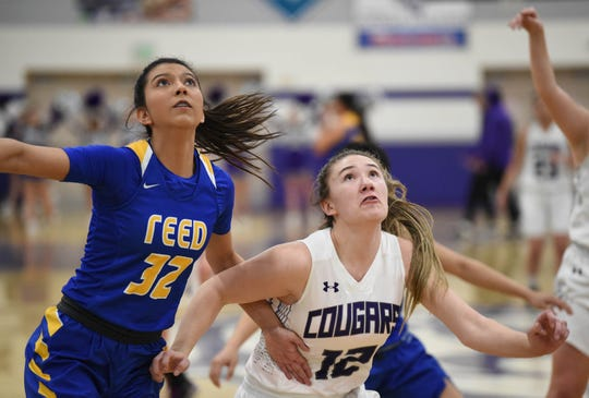 Reed's Larsa Guzman and Spanish Springs' Amelia Delmora look for the rebound  at Spanish Springs on Jan. 29.
