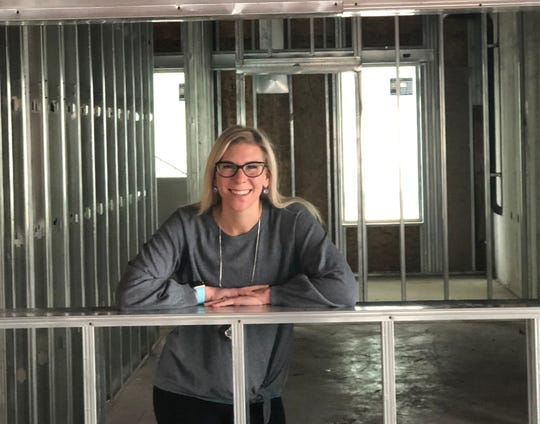 Shila Morris, president and co-owner of the Squeeze In restaurants, takes a moment in the kitchen window of the new Carson City location opening Feb. 28, 2019.