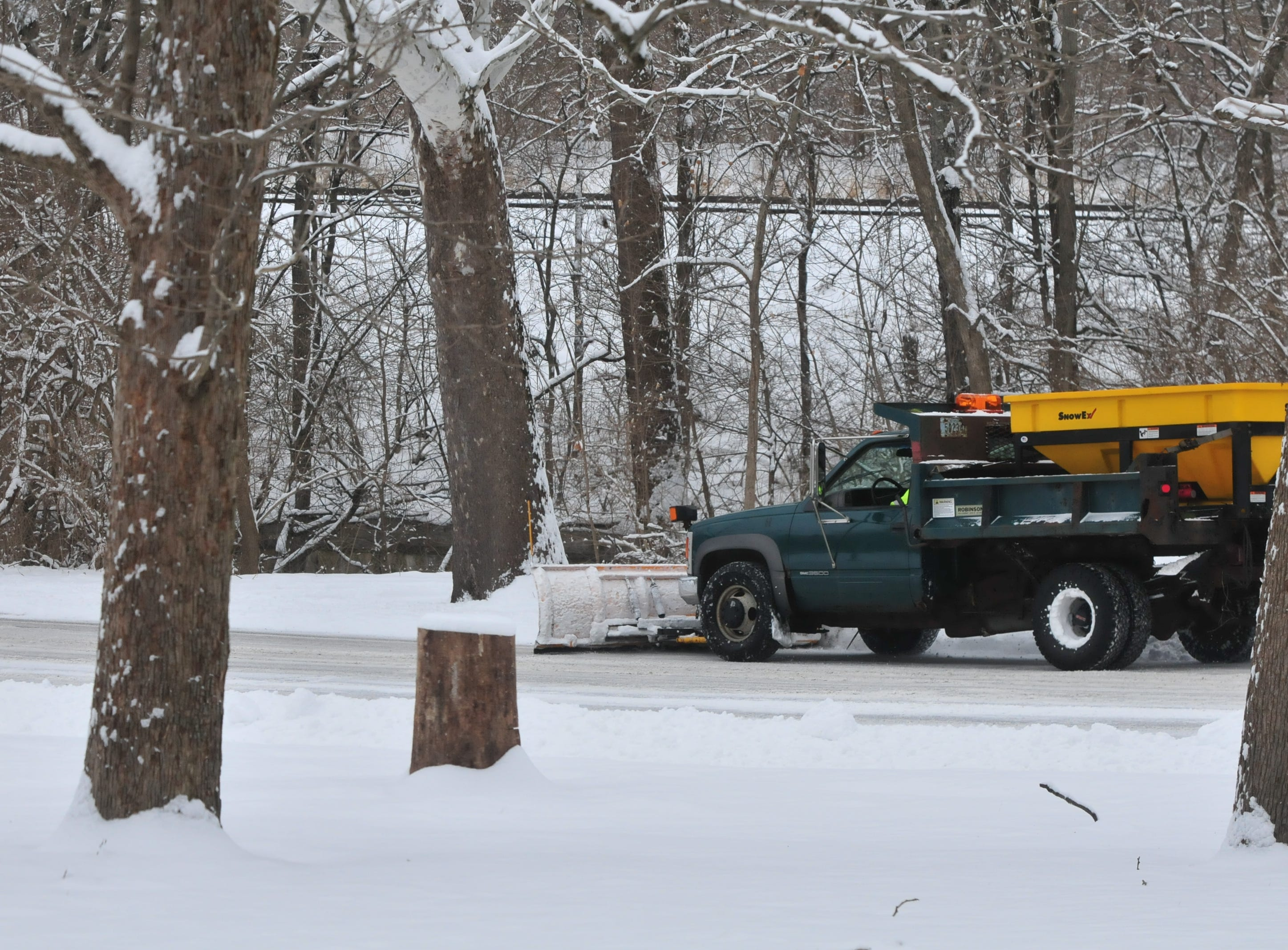 A plow driver worked Friday to clear the roads inside Glen Miller Park.