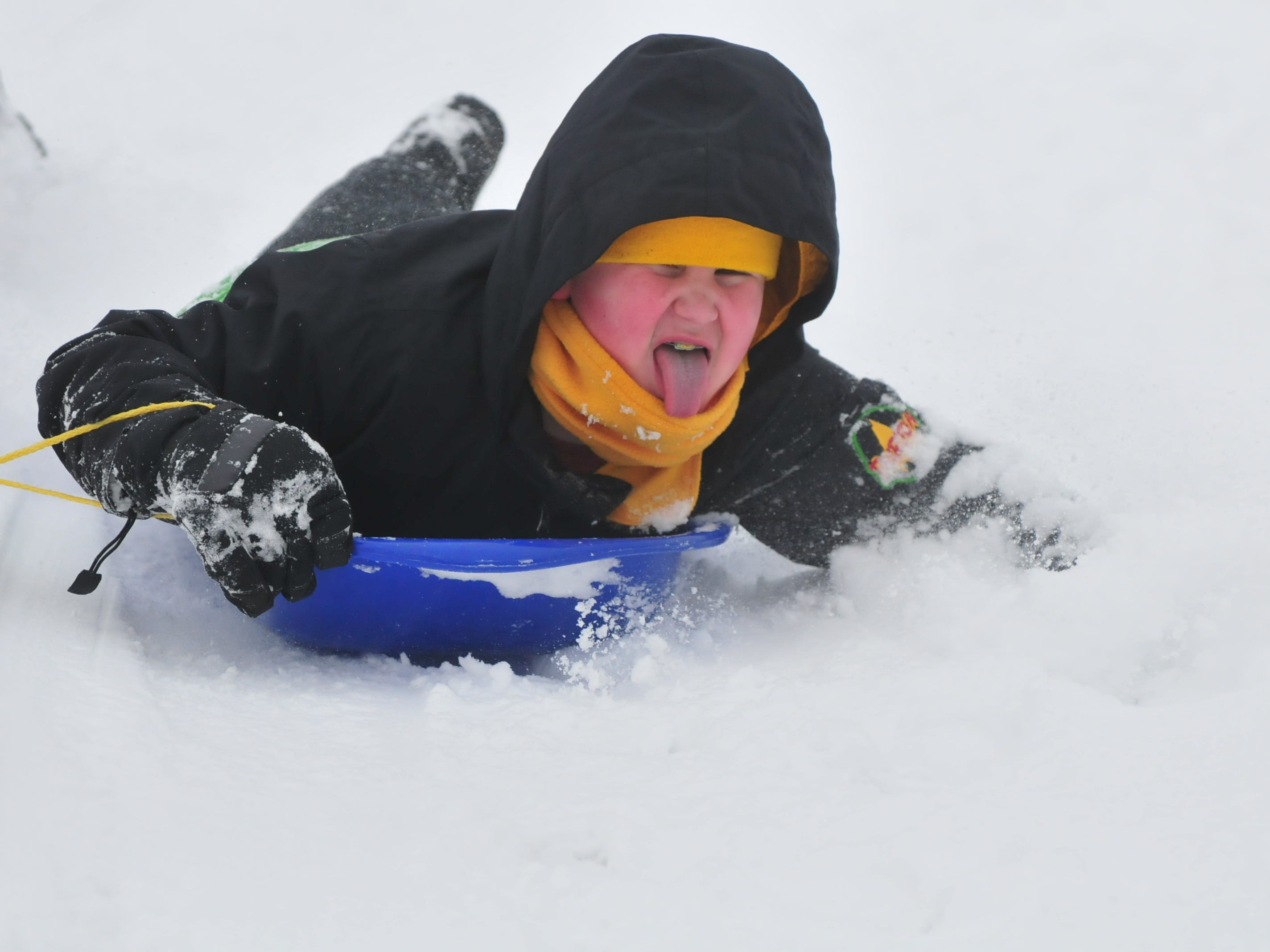 Gavin Belanga sleds Friday at Roosevelt Hill in Glen Miller Park.