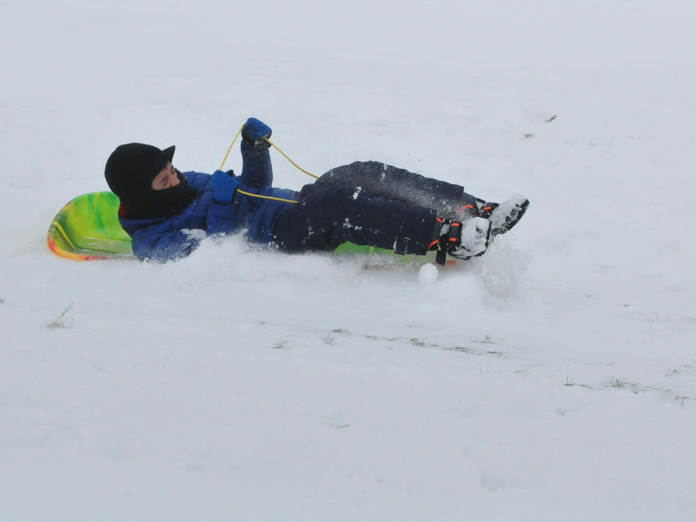 Tyler Amyx sleds Friday at Roosevelt Hill in Glen Miller Park.