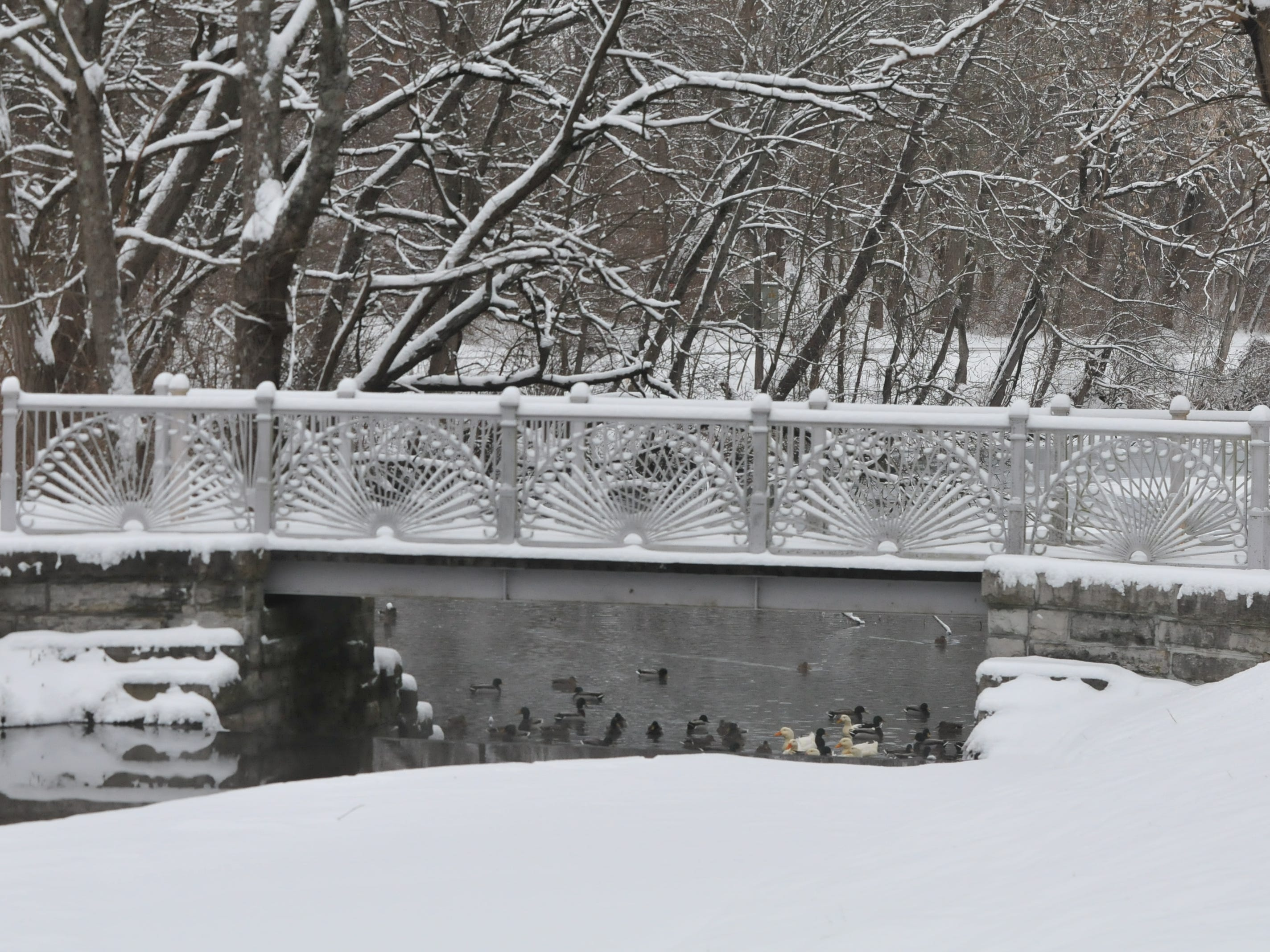 Snow covered the bridge at Glen Miller Park.