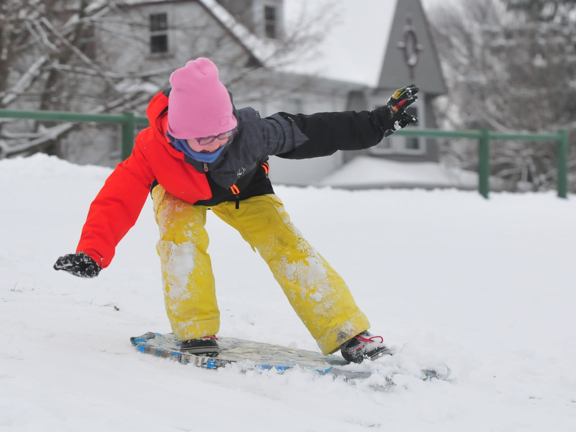 Addie Belanga balances on a sled Friday at Roosevelt Hill in Glen Miller Park.
