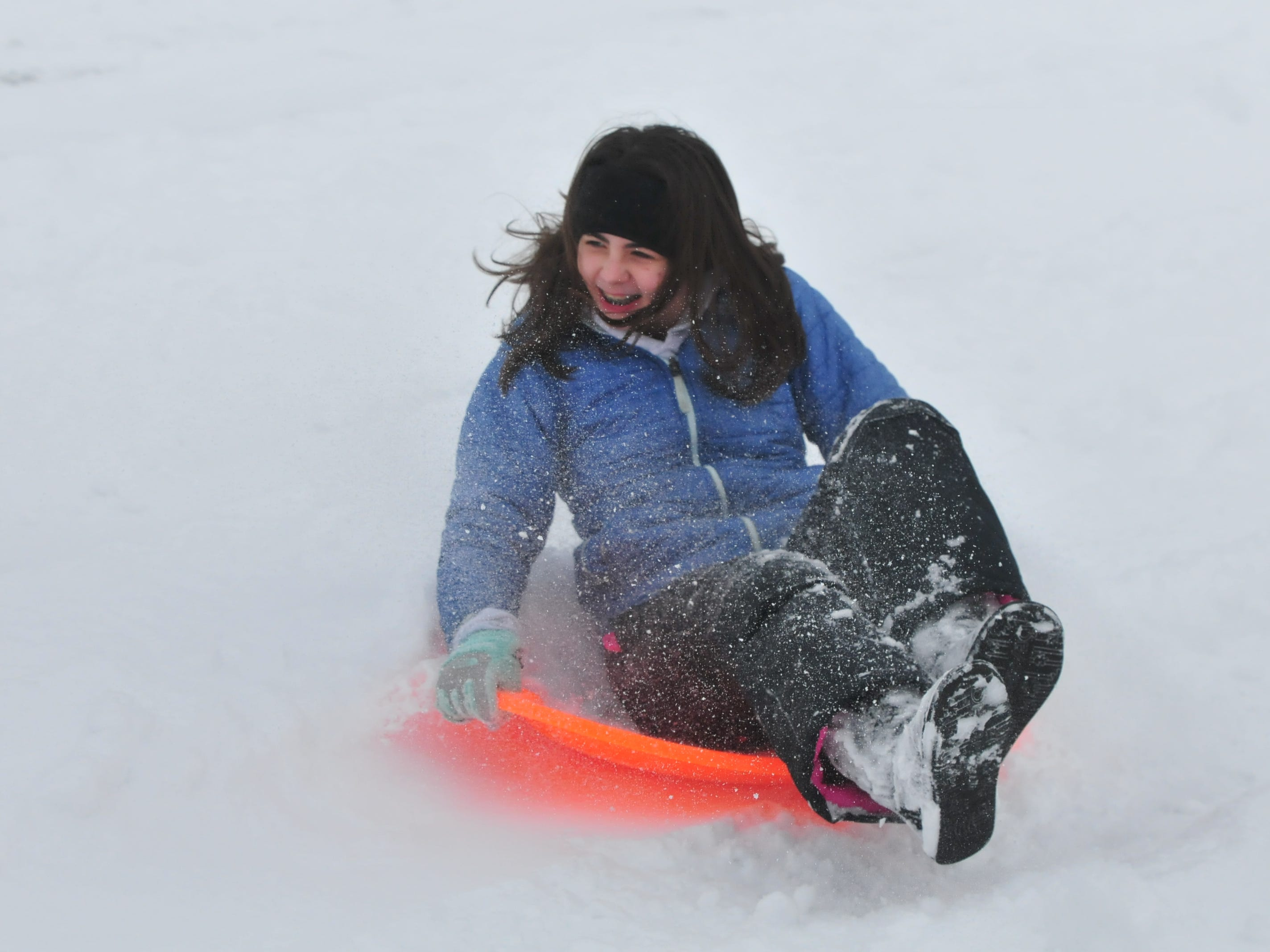 Alyssa Amyx sleds Friday at Roosevelt Hill in Glen Miller Park.
