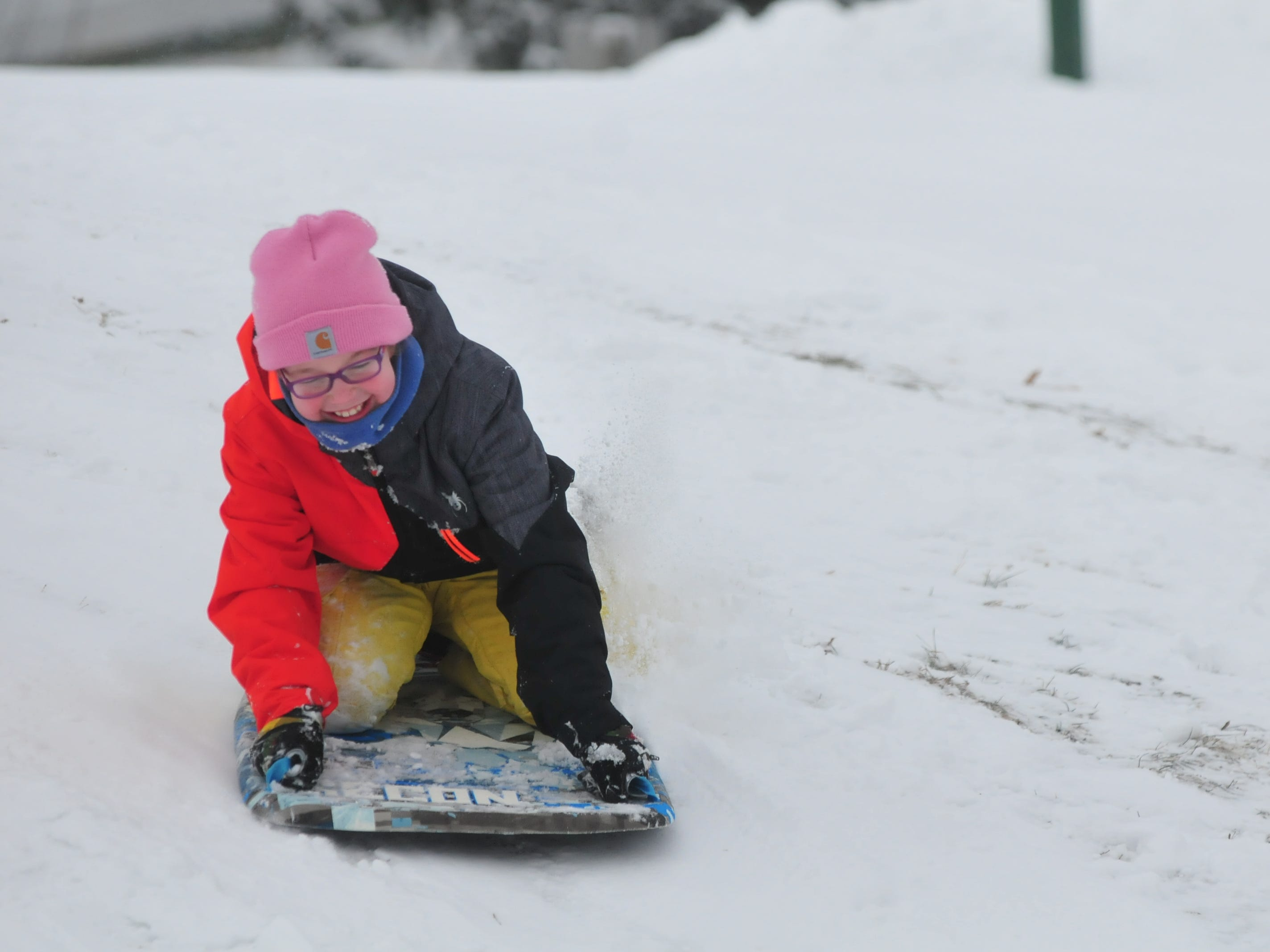 Addie Belanga sleds Friday at Roosevelt Hill in Glen Miller Park.
