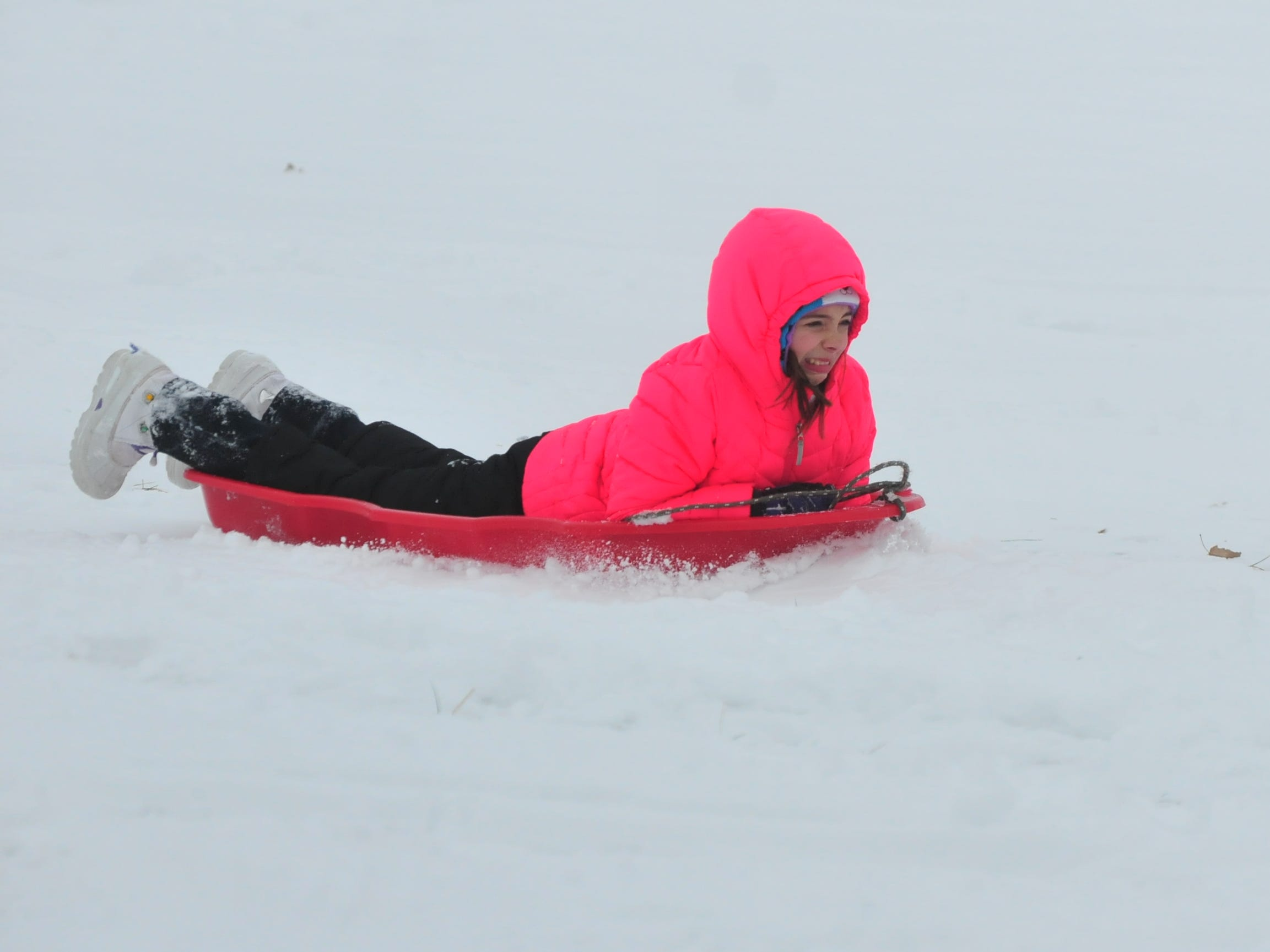 Addison Amyx sleds Friday at Roosevelt Hill in Glen Miller Park.