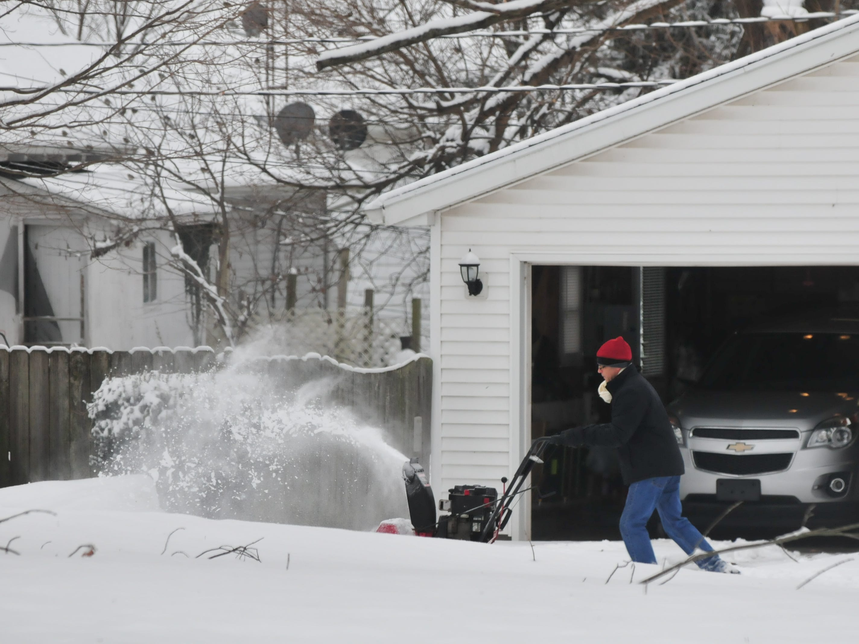 A snowblower is used to clear snow Friday near Glen Miller Park.