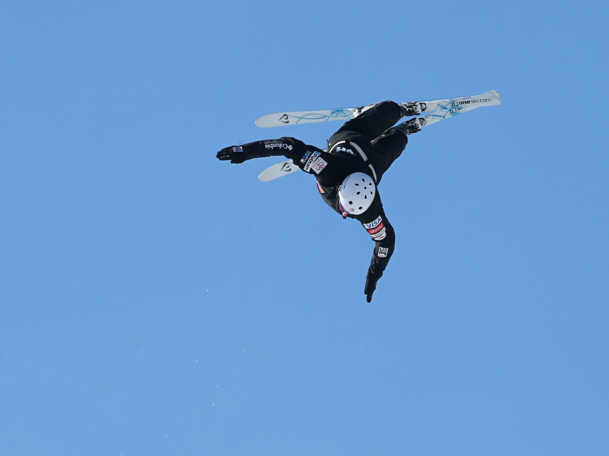 THE PHOTO: Patrick O'Flynn of Rochester, member the U.S. Ski & Snowboard Team Freestyle (Aerials), flips and spins on his first jump of the day at the new Freestyle Aerial Ski jump facility at Bristol Mountain ski resort in Canandaigua Sunday, Jan, 13. FROM SHAWN: This was the first time I have ever photographed aerial skiing - it's amazing, insane, and ridiculously fast.  Shooting with a 100-400 zoom lens from the base of the jump, you don't really see the skiers until each one shoots off the end of one of the three ramps at Bristol.  Then it's a race to lens the skier and make some cool photos as they spin and land.