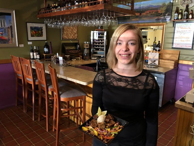 Server Katie Mae Gonko serves a Thai coconut curry for lunch at Cafe Paradisio on Yuba Street in downtown Redding.