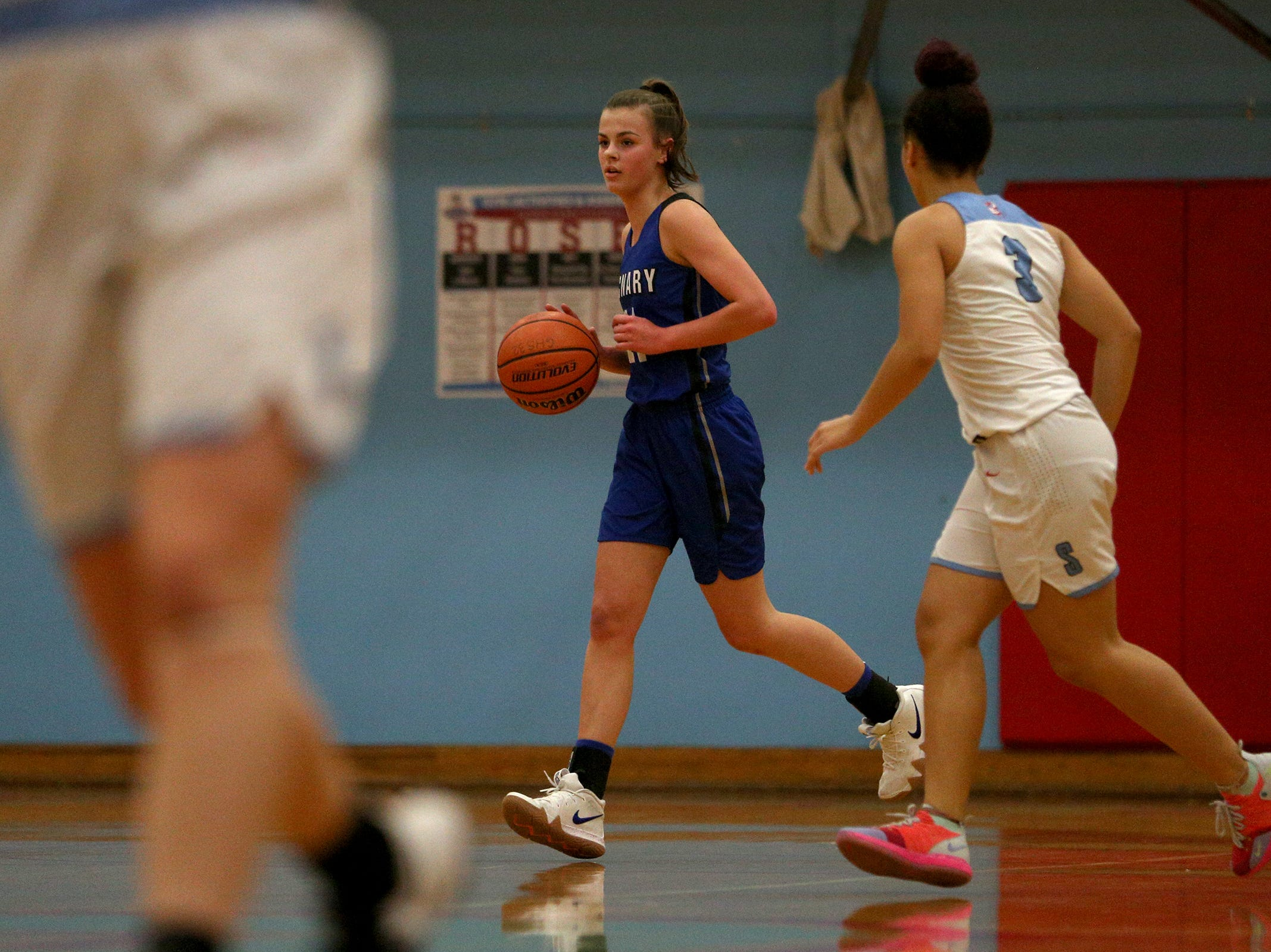 McNary's Leah Doutt (14) dribbles during the South Salem High School girls basketball game against McNary High School in Salem on Thursday, Jan. 31, 2019.