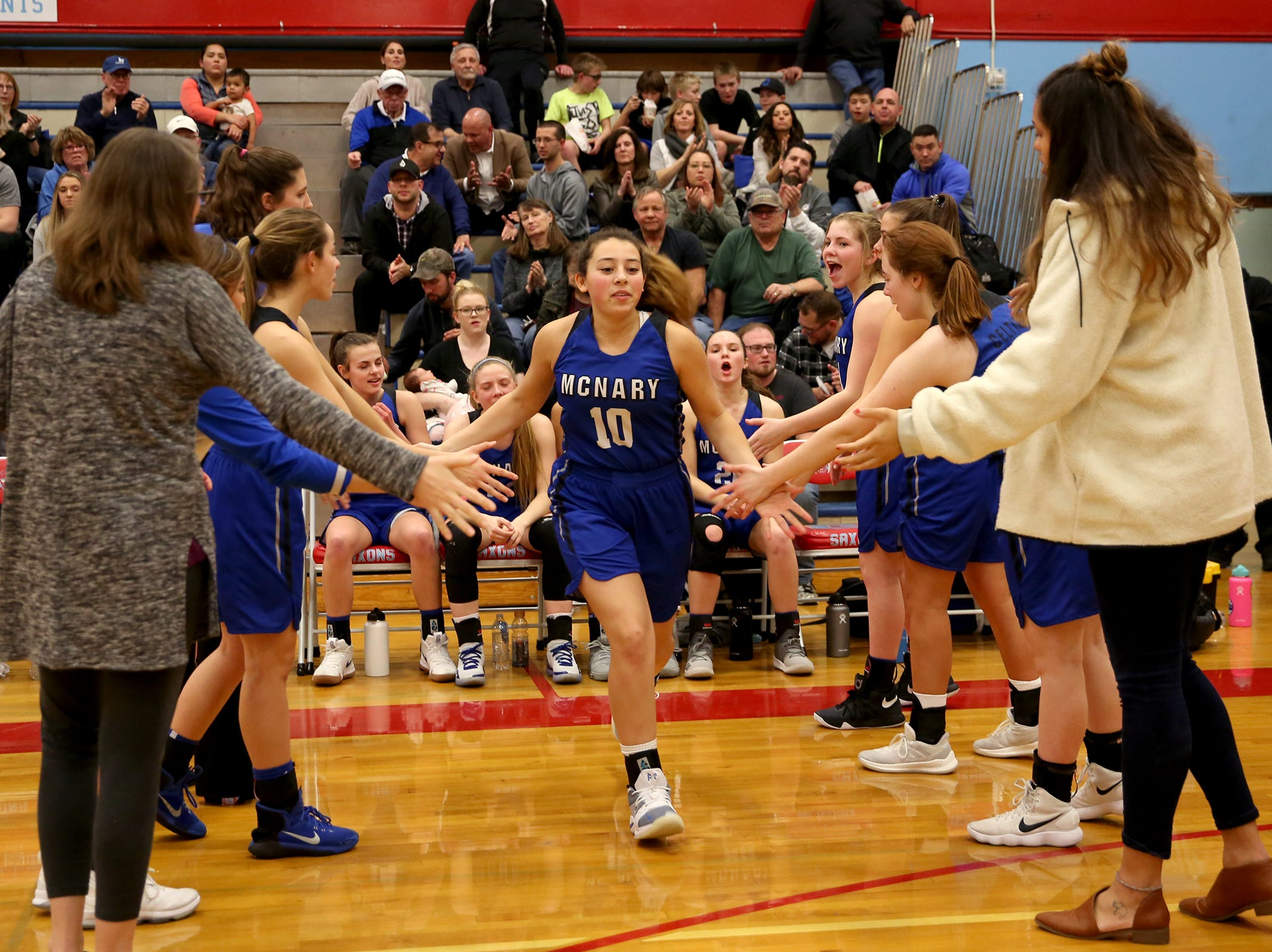 McNary's Sabella Alfaro (10) is introduced in the starting lineup before the South Salem High School girls basketball game against McNary High School in Salem on Thursday, Jan. 31, 2019.