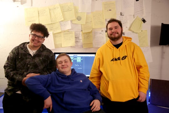 Caleb McDonald, 18, from left, Andrew McMains, 17, and David Bond, 18, all of Salem, at IKE Box in Salem on Thursday, Jan. 31, 2019. Songs the teens wrote placed in the Teens Make Music national competition, organized by MusiCares, and they will travel to this year's GRAMMY Awards in Los Angeles.