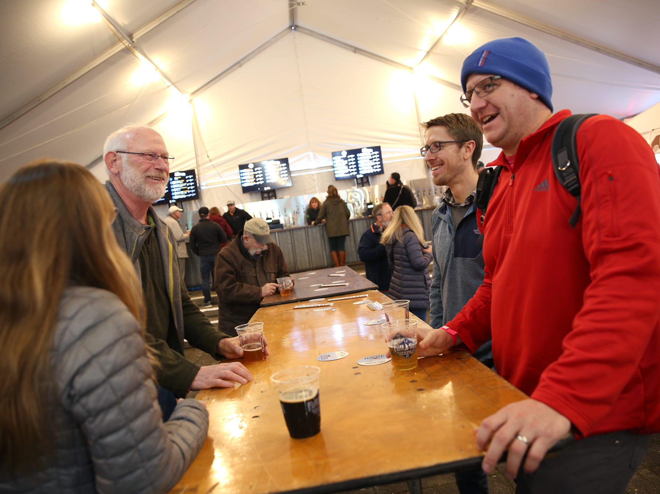 Beer drinkers attend Salem Winter Brewfest in downtown Salem in front of the Oregon State Capitol on Thursday, Jan. 31, 2019.