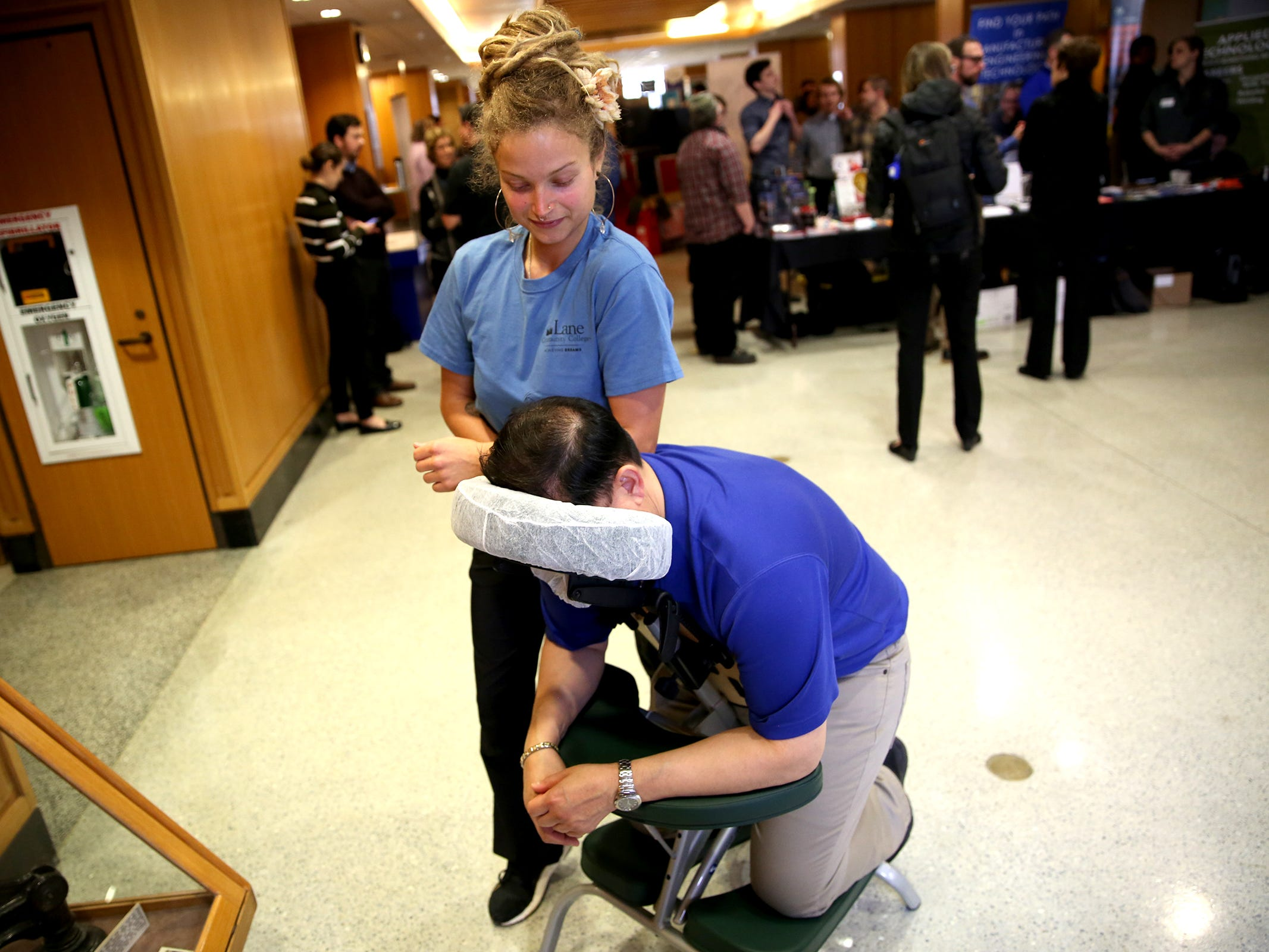 Lex Root, a student in the massage program at Lane Community College, demonstrates a massage during Career and Technical Education (CTE) day at the Oregon State Capitol in Salem on Friday, Feb. 1, 2019.