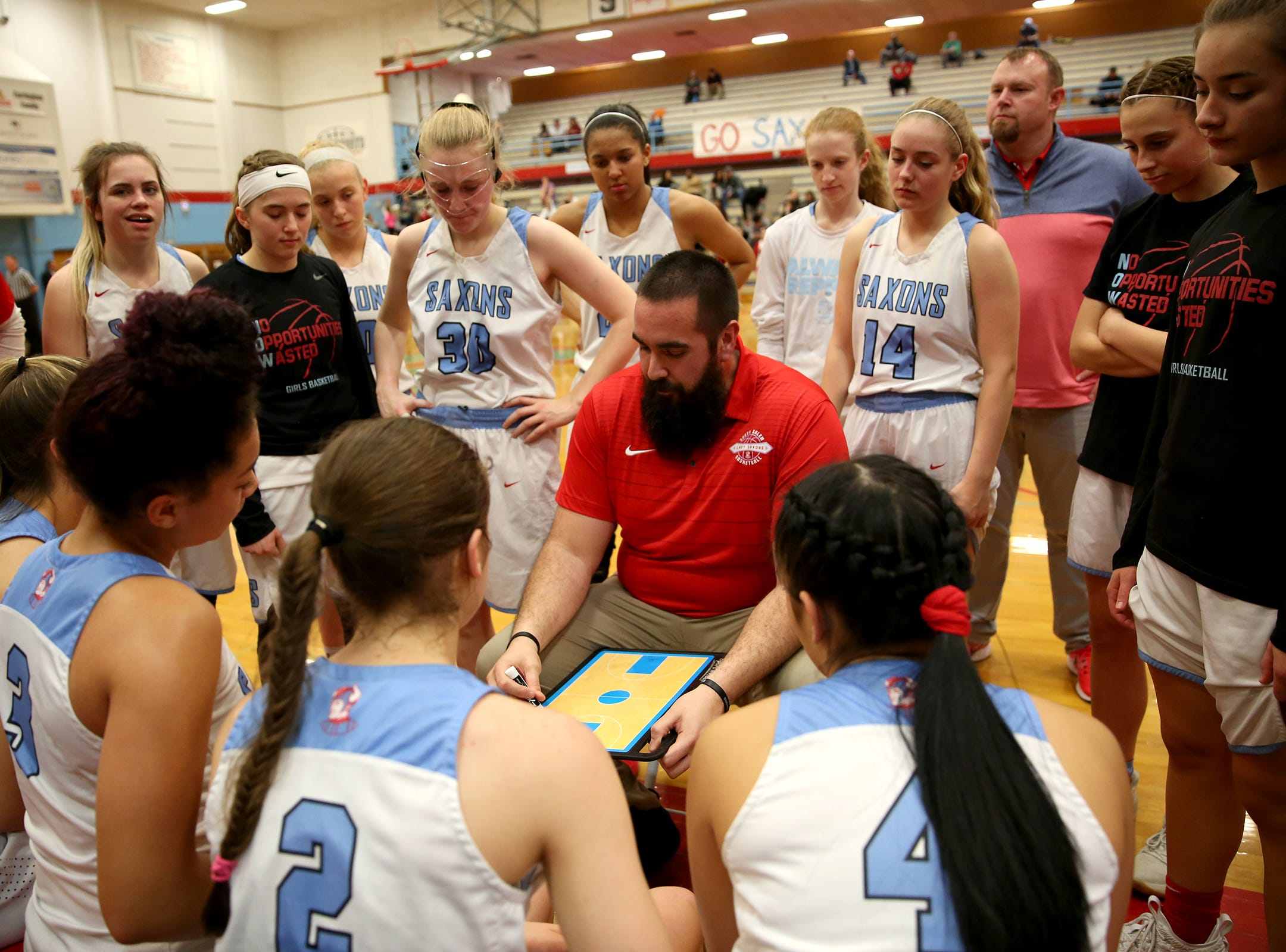South Salem's head coach Adrian Lewis talks to his team during the South Salem High School girls basketball game against McNary High School in Salem on Thursday, Jan. 31, 2019.