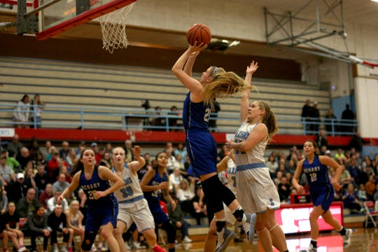 McNary's Abigail Hawley goes up for a shot during the South Salem High School girls basketball game against McNary High School in Salem on Thursday, Jan. 31, 2019.